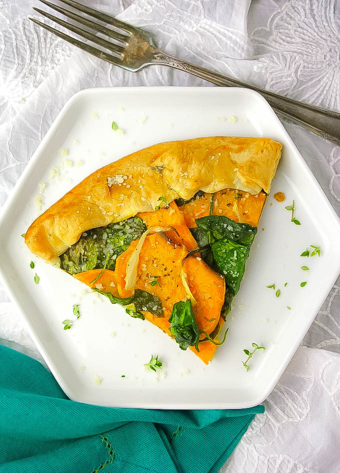 A slice of this delicious Sweet Potato and Spinach Galette will have you convinced this meatless dish is delicious! Sweet Potato and Spinach Galette makes a wonderful vegetarian dish for any day.