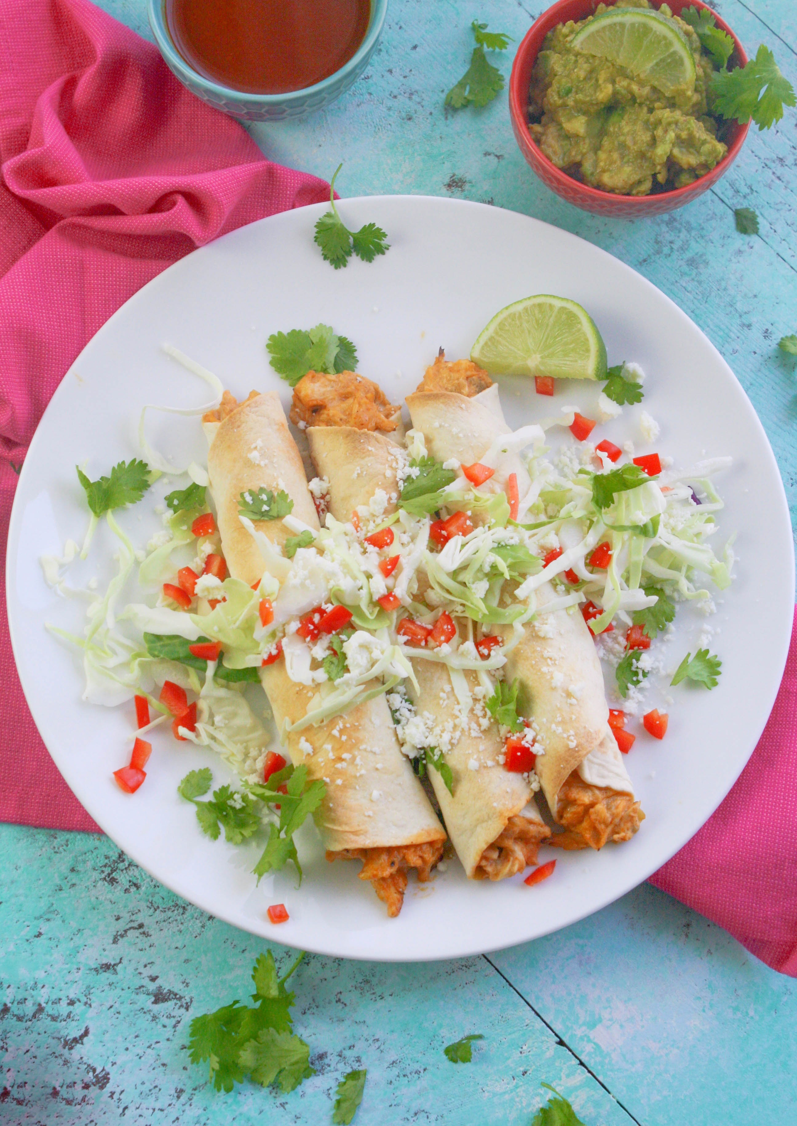 Baked Chicken and Green Chile Taquitos are easy to make for a favorite snack. Baked Chicken and Green Chile Taquitos are a Mexican-inspired favorite dish!
