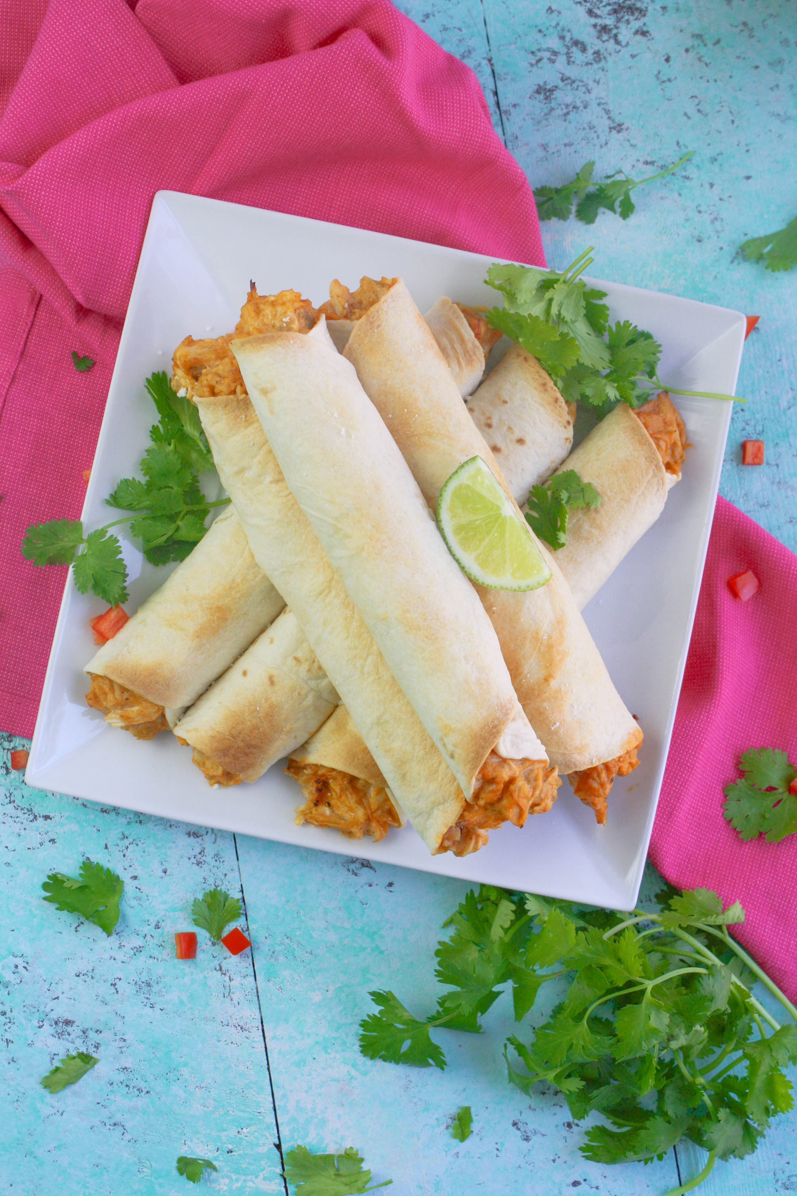 Baked Chicken and Green Chile Taquitos are a treat you will enjoy for a snack or meal. Baked Chicken and Green Chile Taquitos are fun to serve with all sorts of toppings!