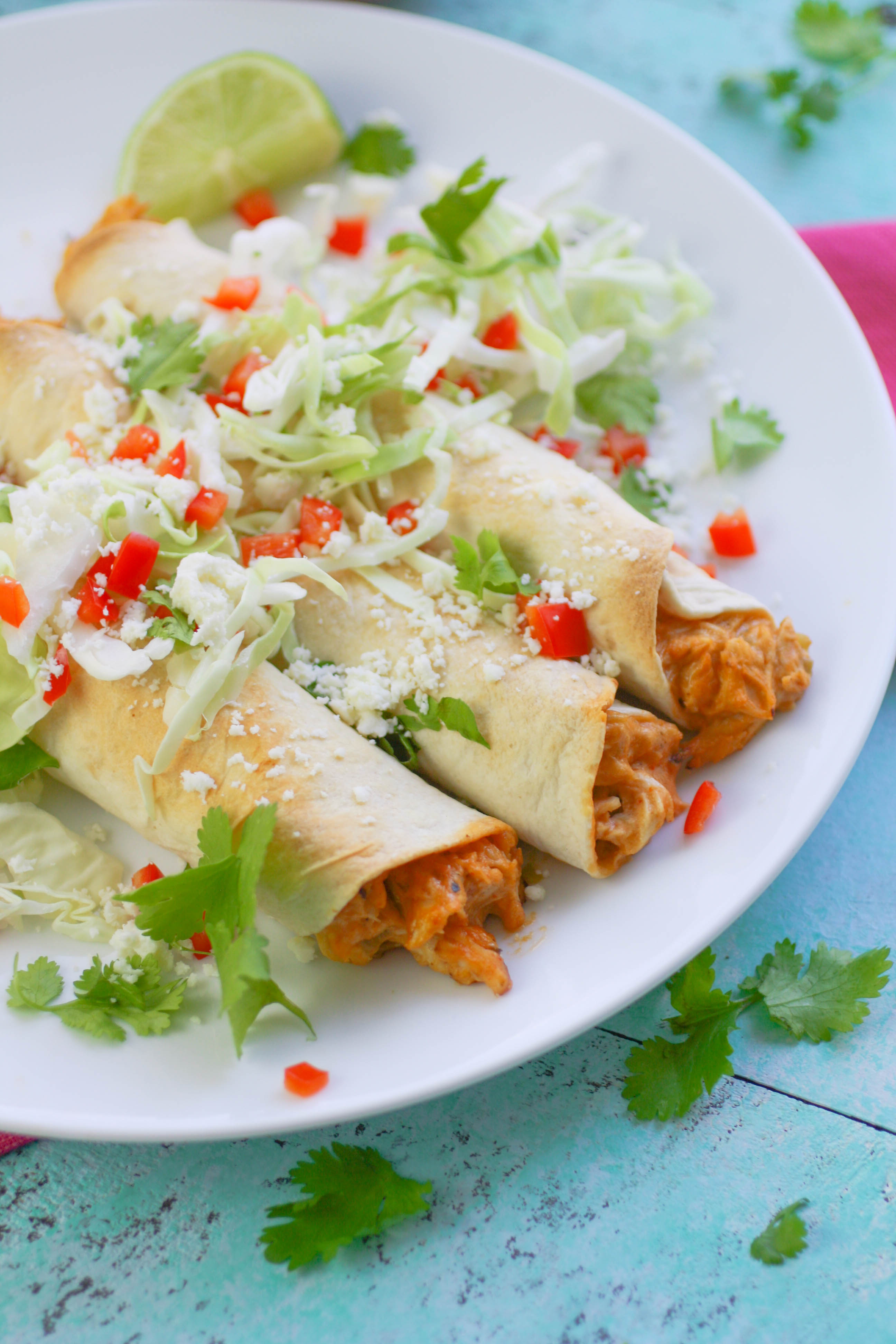 Baked Chicken and Green Chile Taquitos are filling and easy to make as a snack or part of a light meal. Baked Chicken and Green Chile Taquitos are a Mexican-inspired favorite to serve anytime!