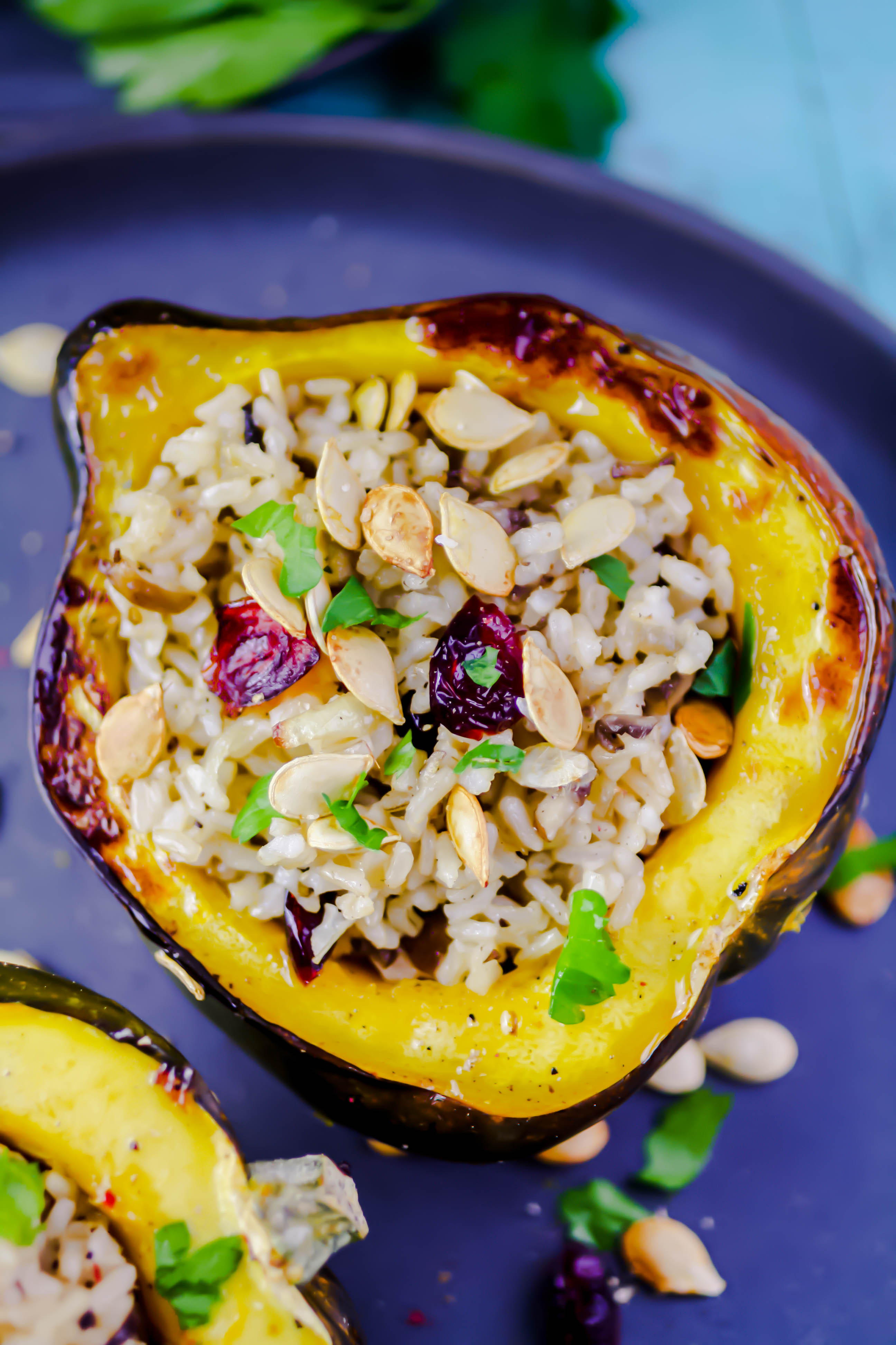 Acorn Squash Stuffed with Brown Rice, Mushrooms, and Cranberries is such a pretty dish to serve for a special meal. Acorn Squash Stuffed with Brown Rice, Mushrooms, and Cranberries is easy to make and fun to serve.
