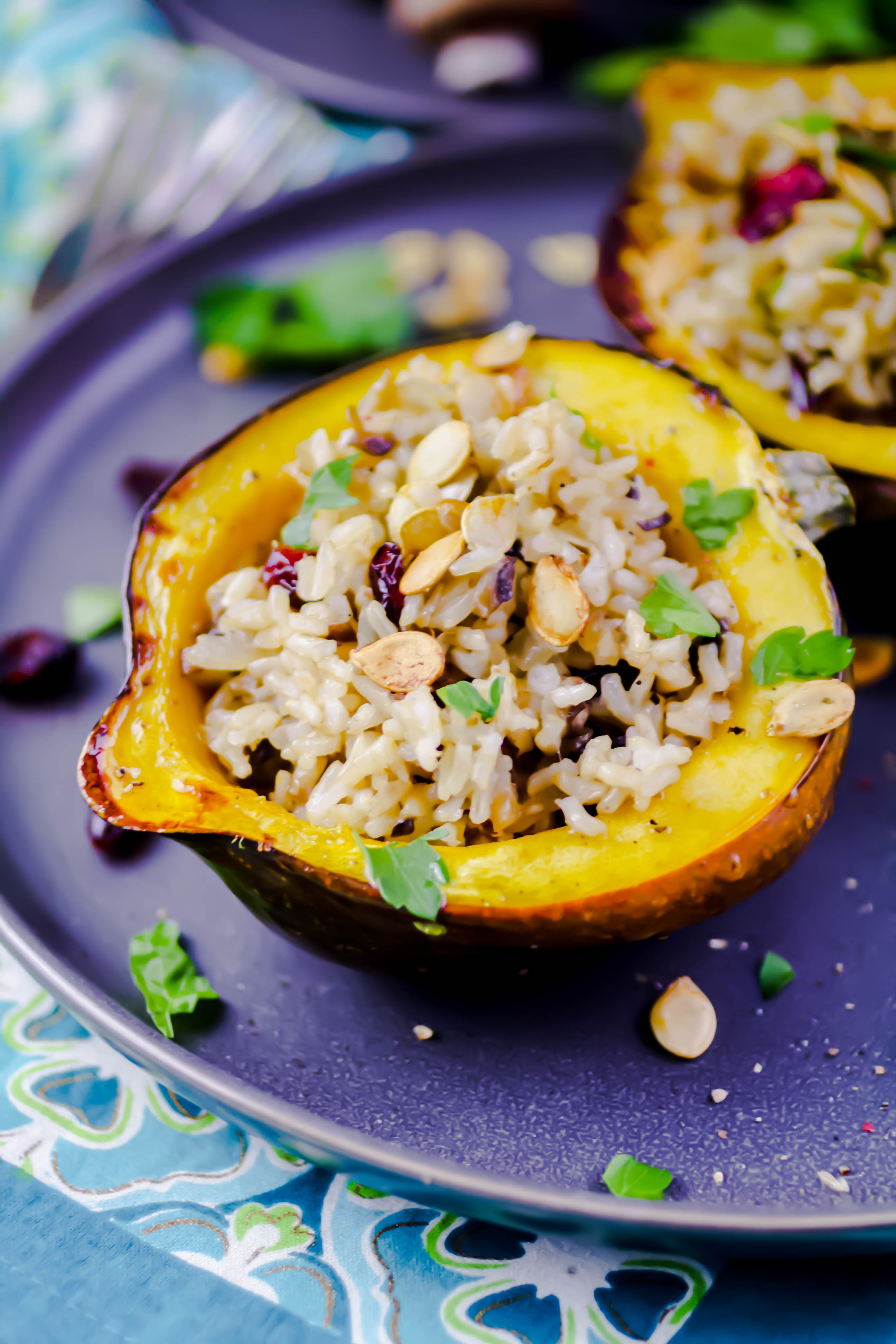 Acorn Squash Stuffed with Brown Rice, Mushrooms, and Cranberries is a lovely meal. Acorn Squash Stuffed with Brown Rice, Mushrooms, and Cranberries is a fun dish to serve -- and it tastes great, too!