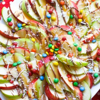 Apple nachos with chocolate & caramel drizzle are festive and fun any day of the week!