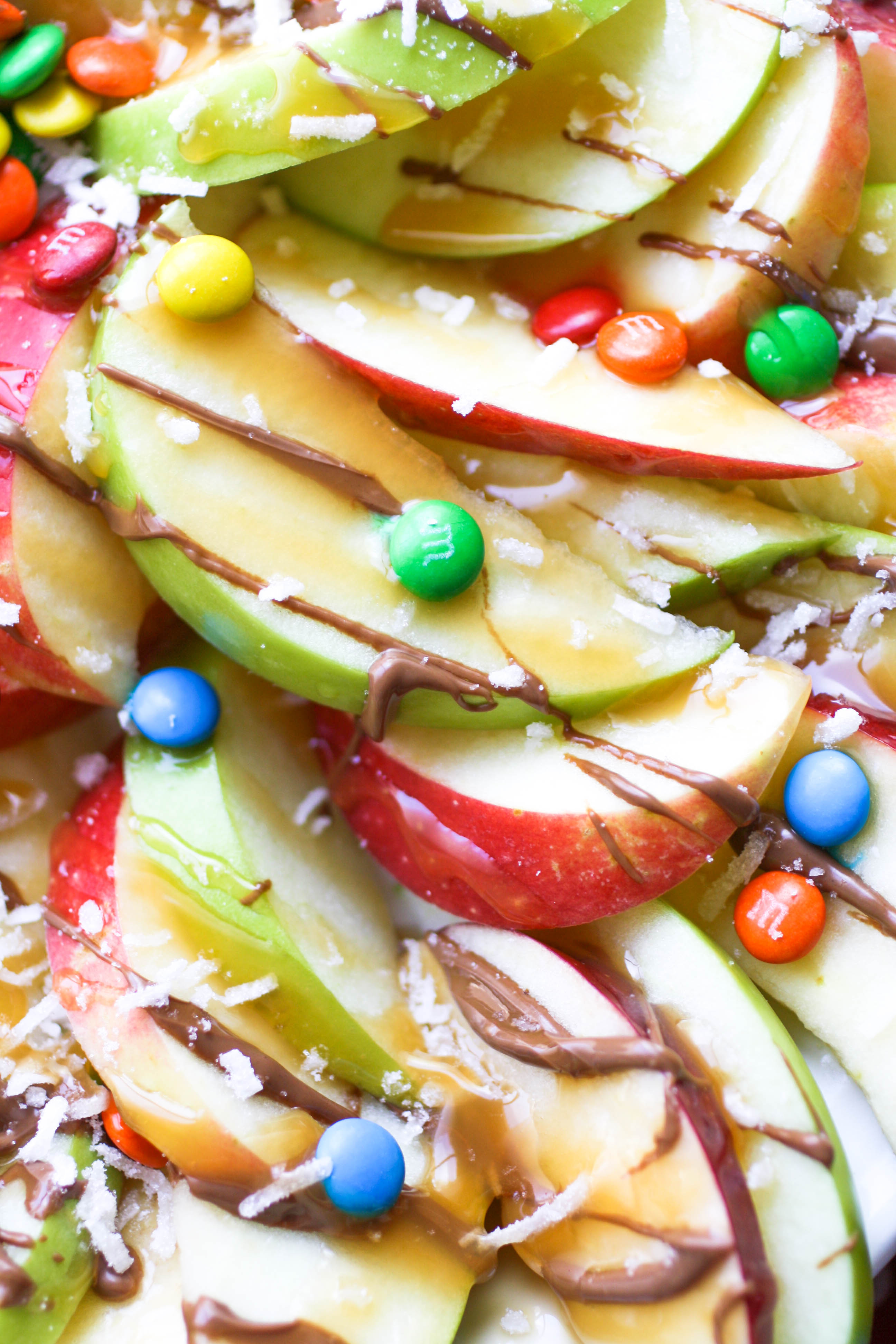 "Apple nachos with chocolate & caramel drizzle are a simple, tasty treat for any day! Everyone will love these ""nachos!"""