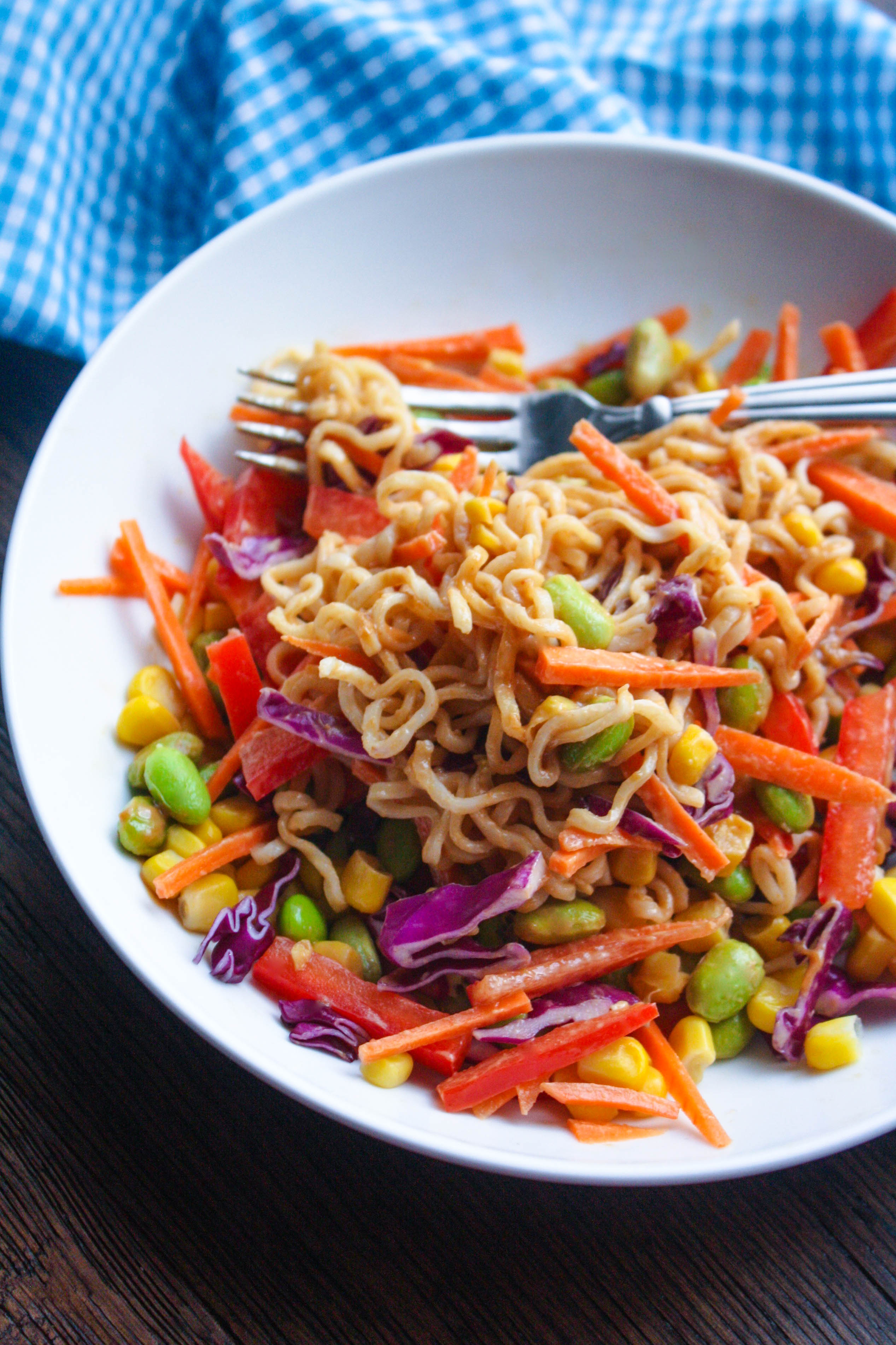 Asian Noodle Salad in a Jar with Spicy Peanut Dressing is a salad you'll reach for again and again. It's filled with great veggies and crunch, and a delicious dressing!