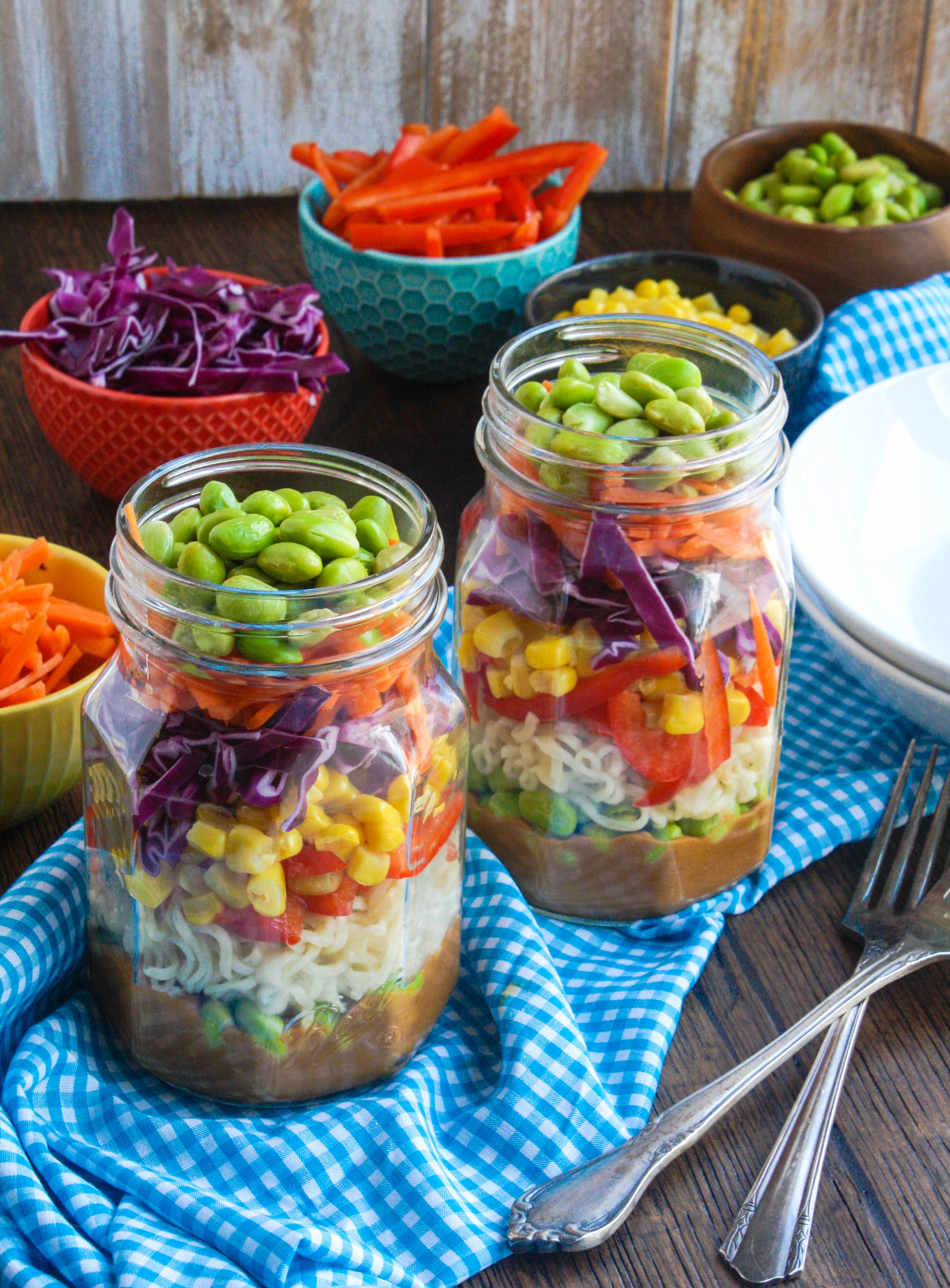 Asian Noodle Salad in a Jar with Spicy Peanut Dressing is a fun way to serve your next salad. It's totally delicious, too!