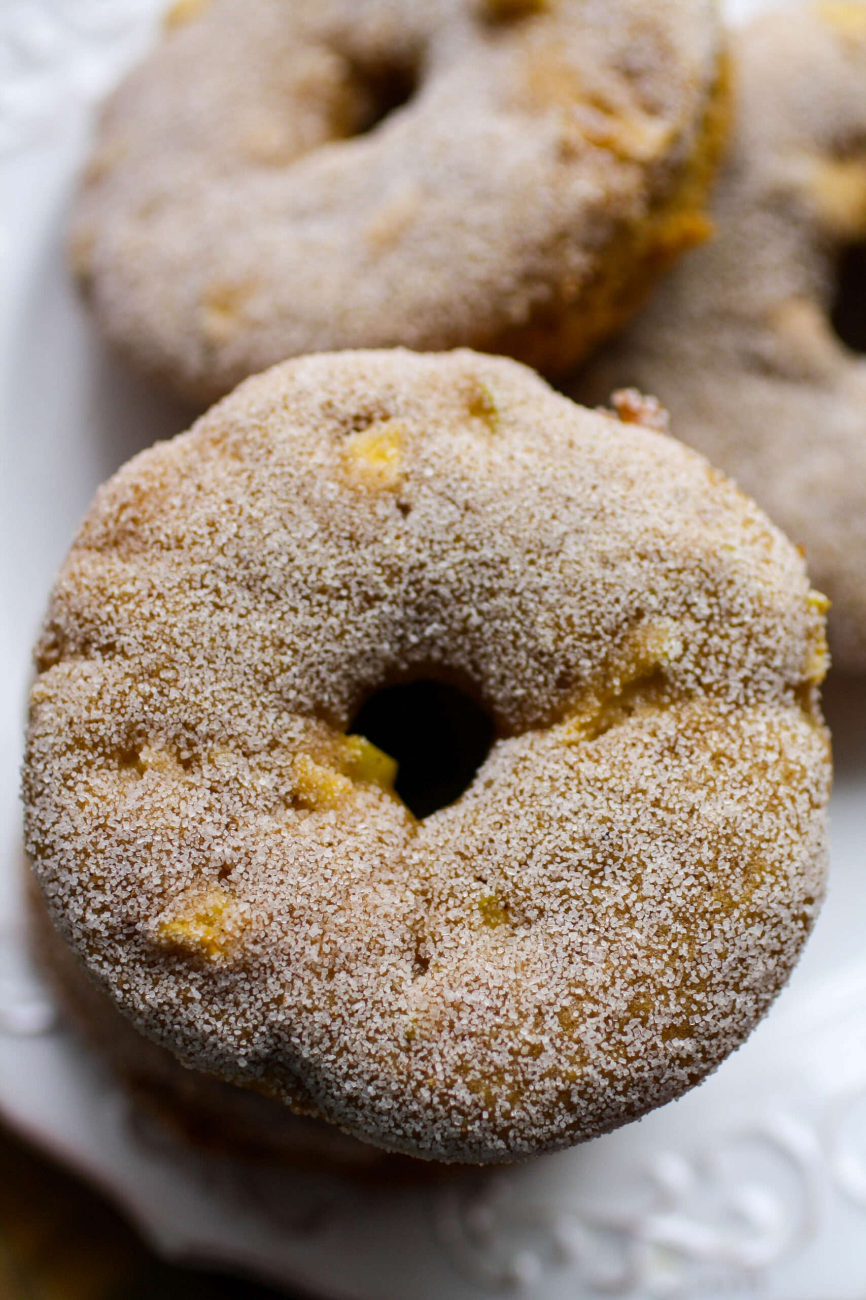 Baked Apple Cinnamon Donuts are great whether or not they're coated in cinnamon-sugar!