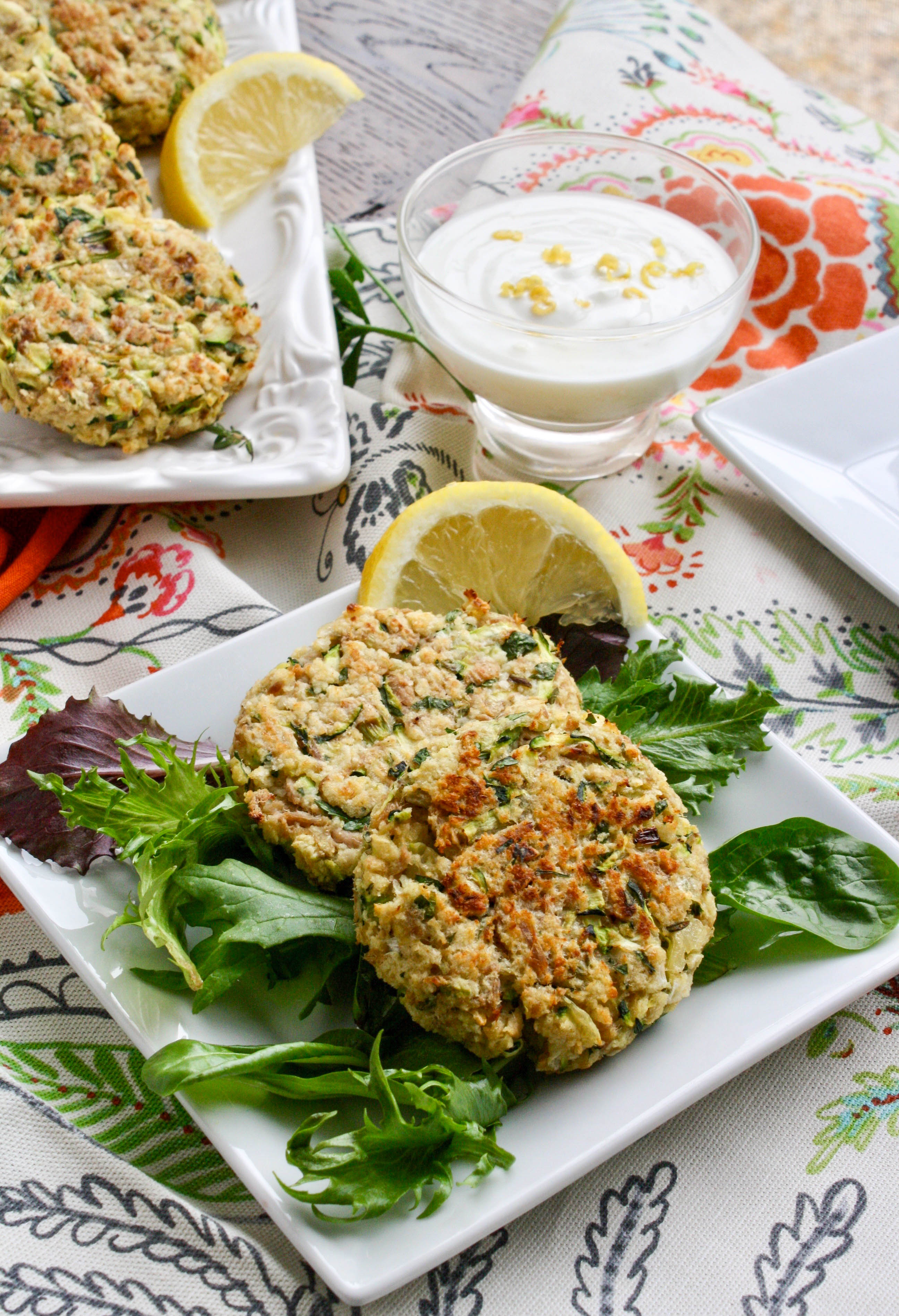 Baked Tuna and Zucchini Cakes with Lemon-Yogurt Dressing are a lovely addition to lunch or dinner. They're easy to make, and so flavorful!