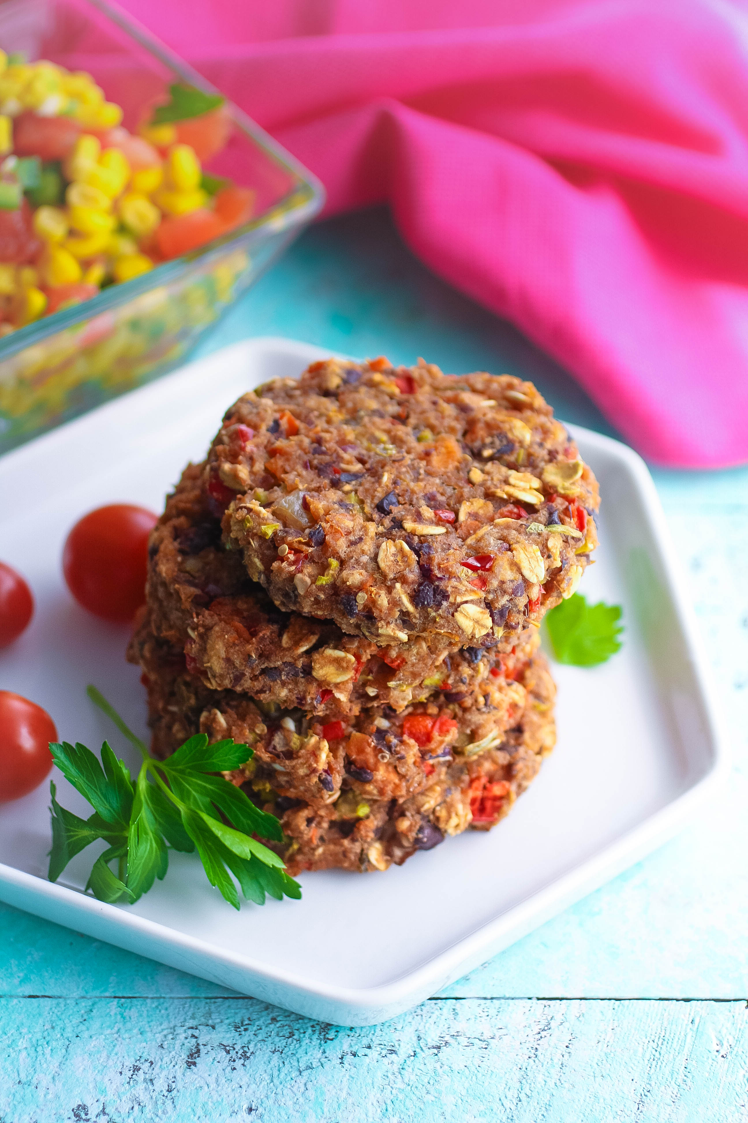 Black Bean Veggie Burgers with Corn Salsa stack up as a great meatless meal. These Black Bean Veggie Burgers with Corn Salsa are filling and flavorful!