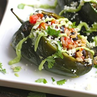 Black Bean and Rice Stuffed Poblano Peppers with Avocado Cream are warm and filling, and a great meatless dish.