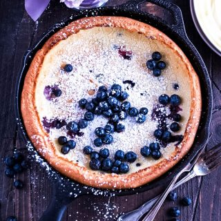 Blueberry Dutch Baby Pancake is a treat for a special breakfast or brunch. You'll love this Blueberry Dutch Baby Pancake!