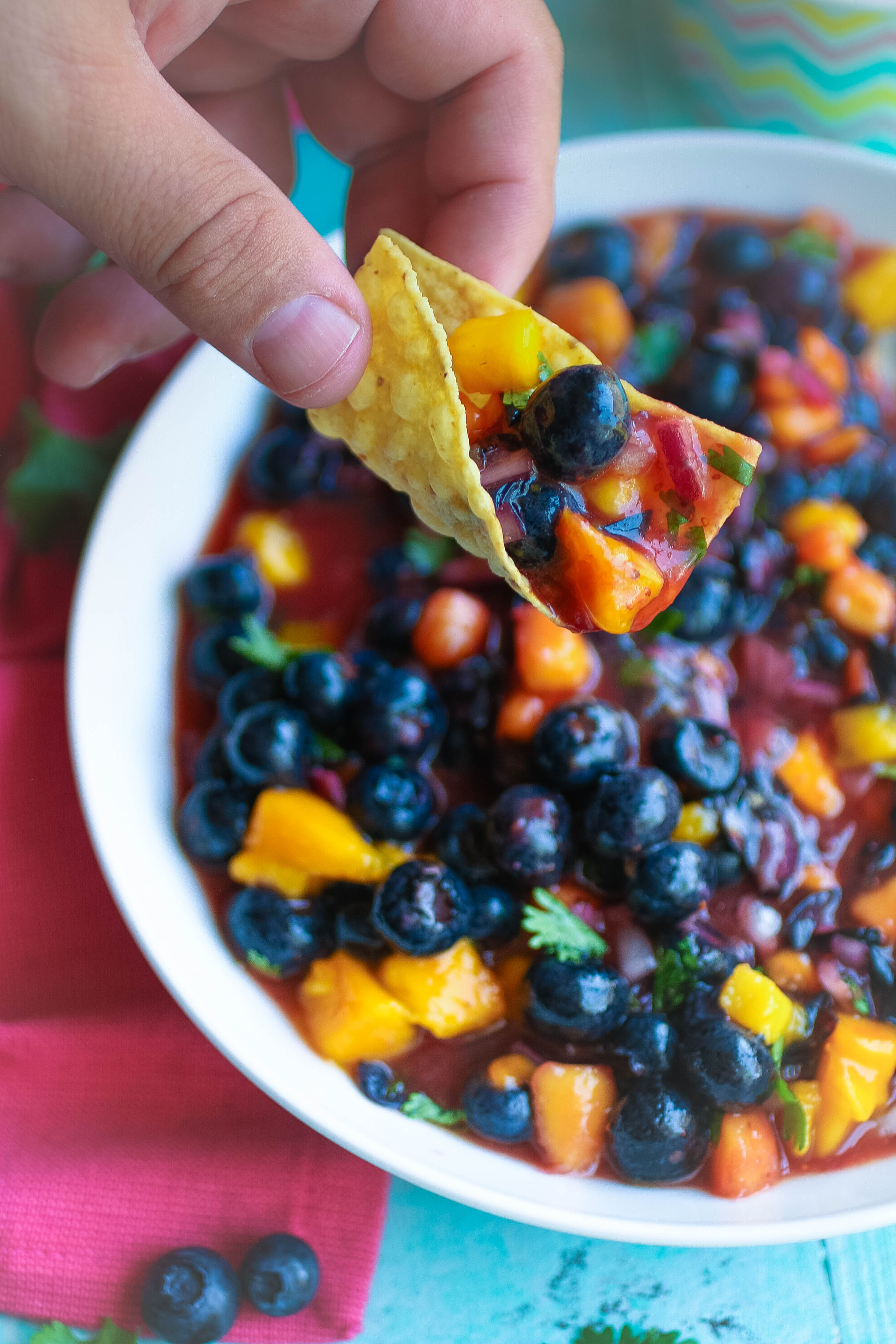 You'll want to dig in to this Blueberry-Mango Salsa. Blueberry-Mango Salsa is a delightful snack for the summer!