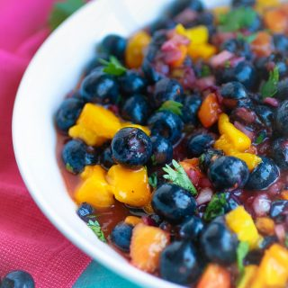 Blueberry-Mango Salsa is a snack you'll want to dig into over and over again this season! Blueberry-Mango Salsa is a tasty and easy snack for the season.