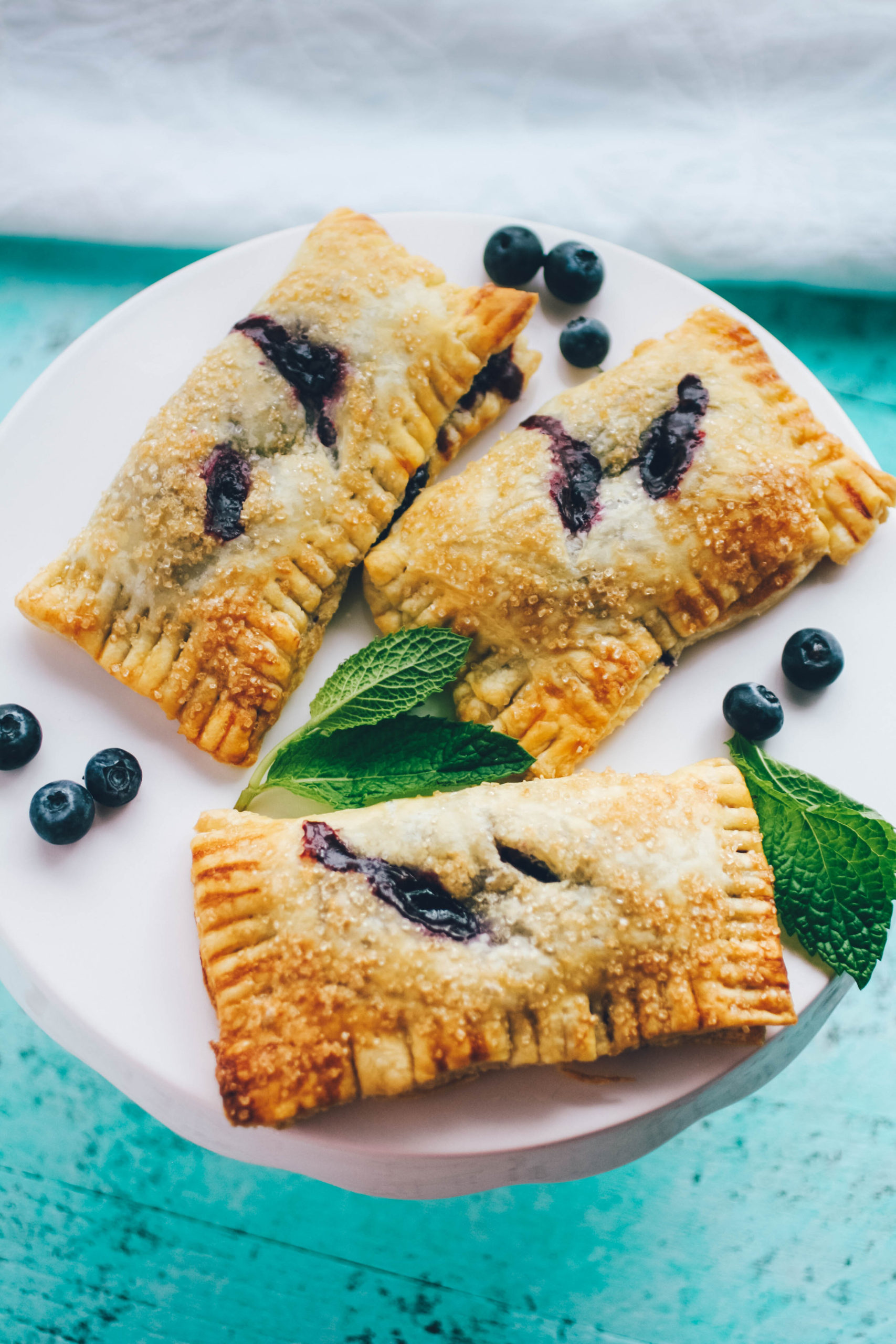 Blueberry Mint Hand Pies are wonderful for a summer dessert! You'll love these Blueberry Mint Hand Pies.