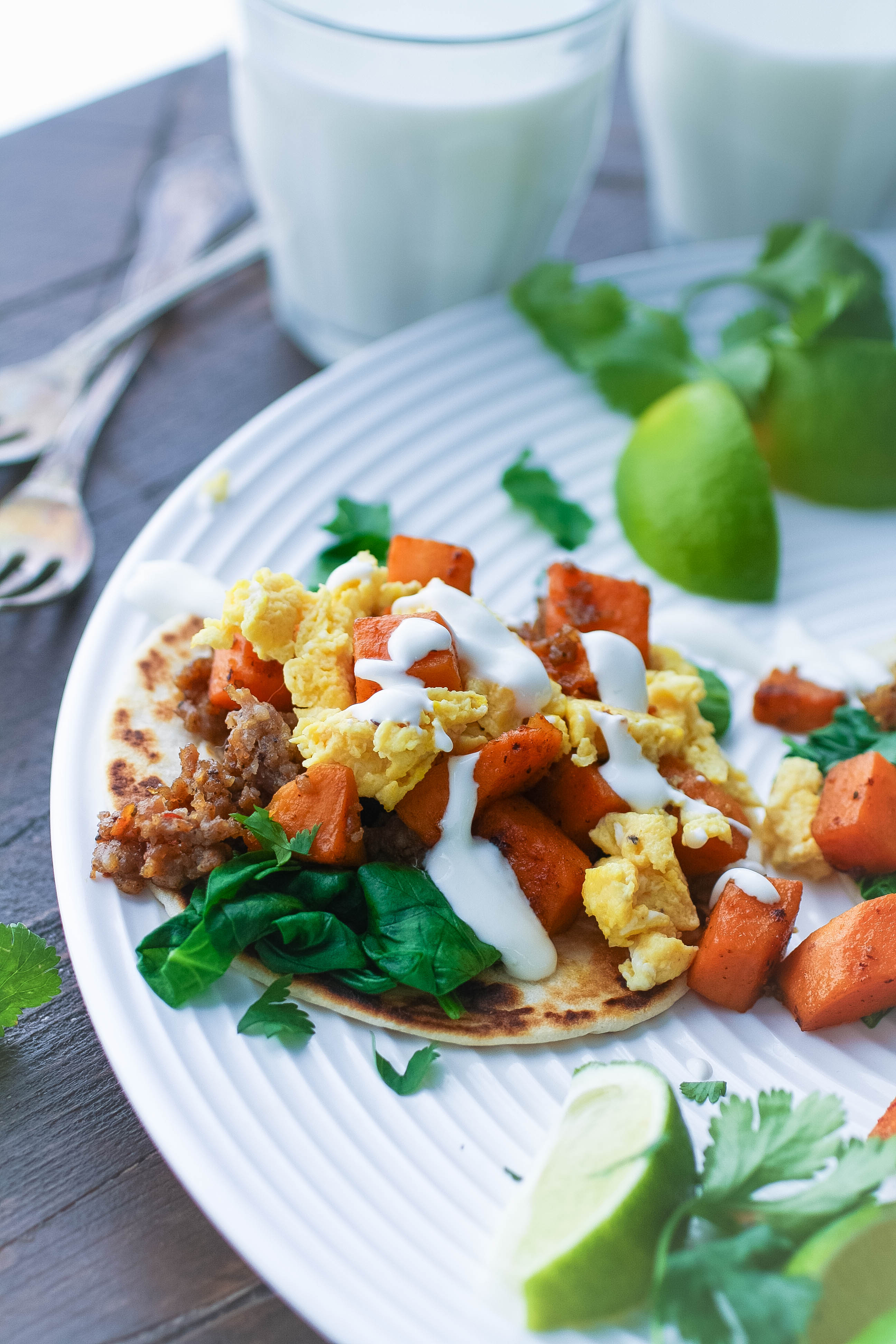 Breakfast Tacos with Sweet Potatoes, Sausage, Spinach, and Lime Crema are tasty tacos, for sure! Make these Breakfast Tacos with Sweet Potatoes, Sausage, Spinach, and Lime Crema for any meal of the day.