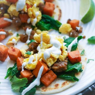 Breakfast Tacos with Sweet Potatoes, Sausage, Spinach, and Lime Crema are so fun to serve early in the day. Breakfast Tacos with Sweet Potatoes, Sausage, Spinach, and Lime Crema are fun for breakfast or brunch!