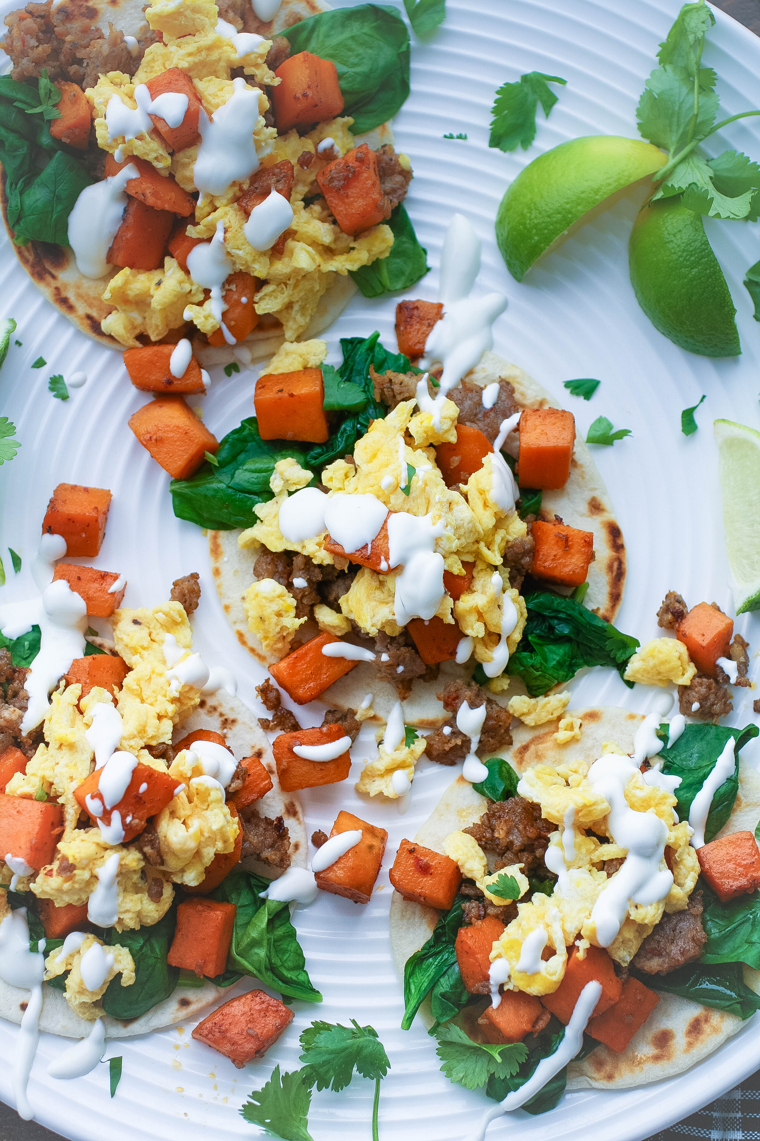 Breakfast Tacos with Sweet Potatoes, Sausage, Spinach, and Lime Crema make a fabulous meal! Breakfast Tacos with Sweet Potatoes, Sausage, Spinach, and Lime Crema are tasty and they make a fun meal!