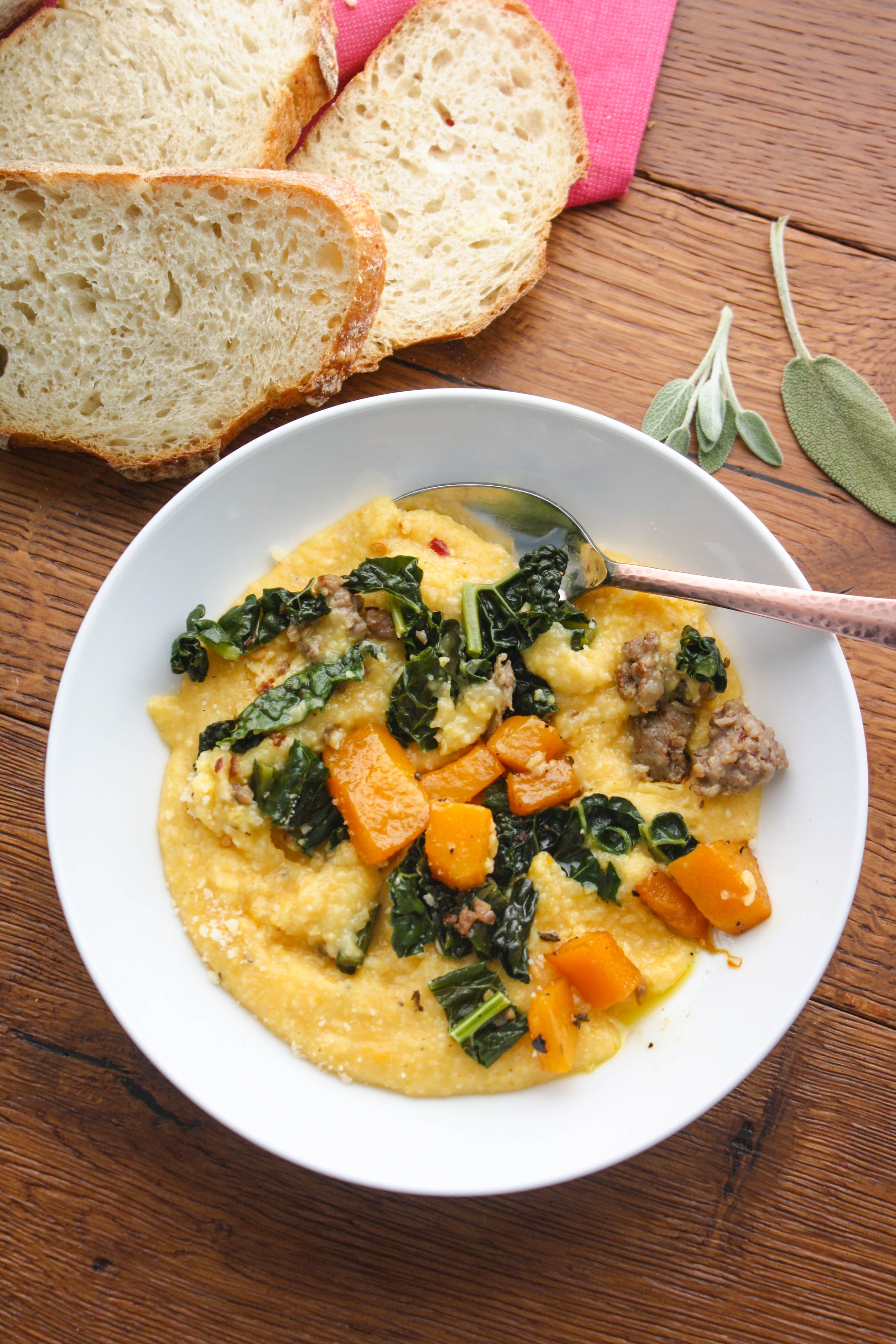 Butternut Squash Grits with Sausage and Kale is a hearty and warming dish to serve when it's cold out. You'll love this hearty and comforting grits dish.