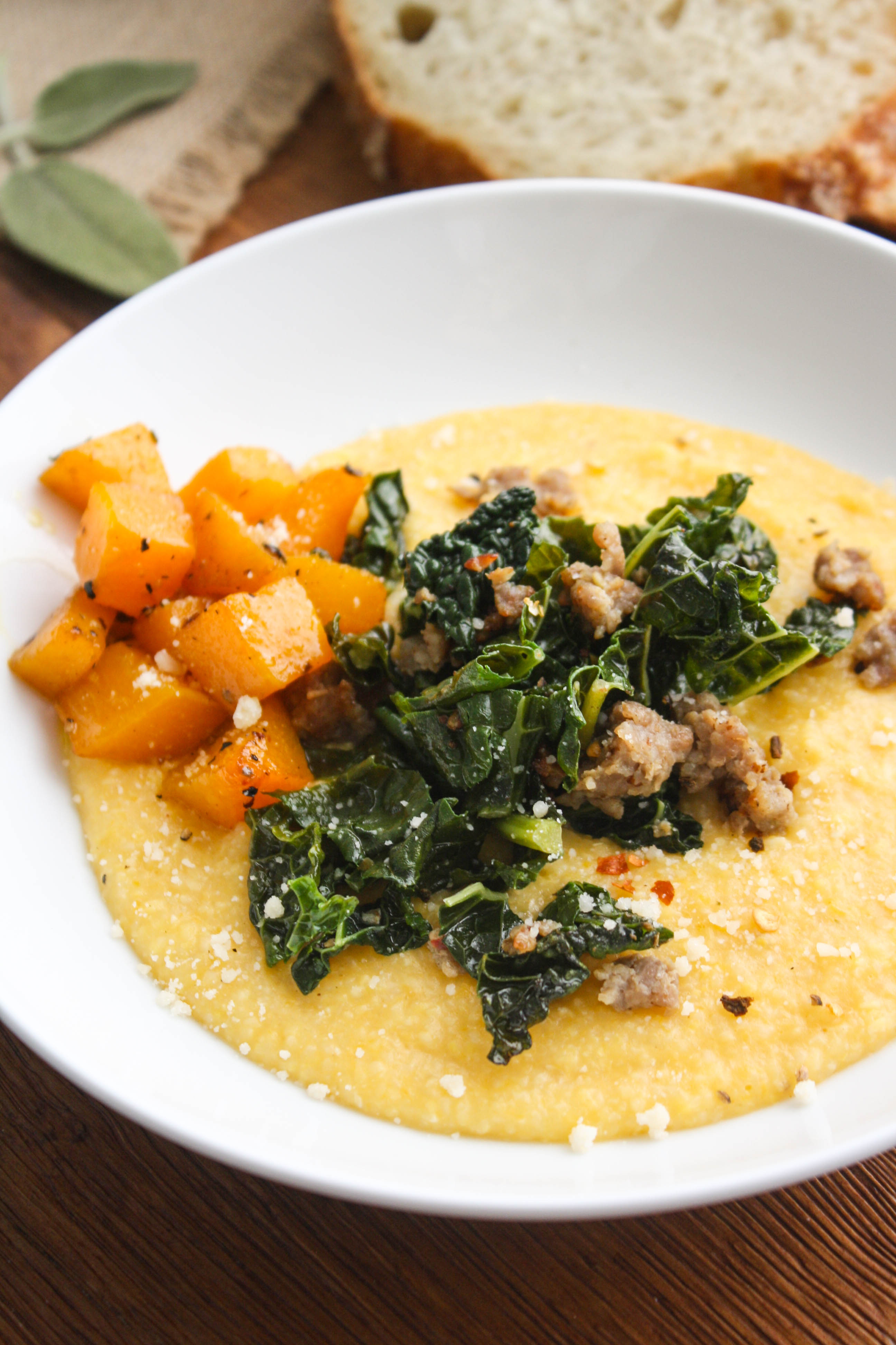 Butternut Squash Grits with Sausage and Kale is a hearty and warming dish. You'll love the flavors in this grits dish!