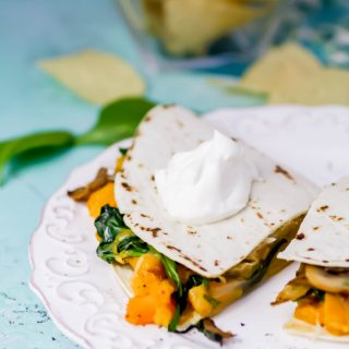 Butternut Squash, Mushroom, Onion, and Spinach Quesadillas make a simple, delicious meal. Butternut Squash, Mushroom, Onion, and Spinach Quesadillas are great as a meatless dish -- you won't miss the meat!