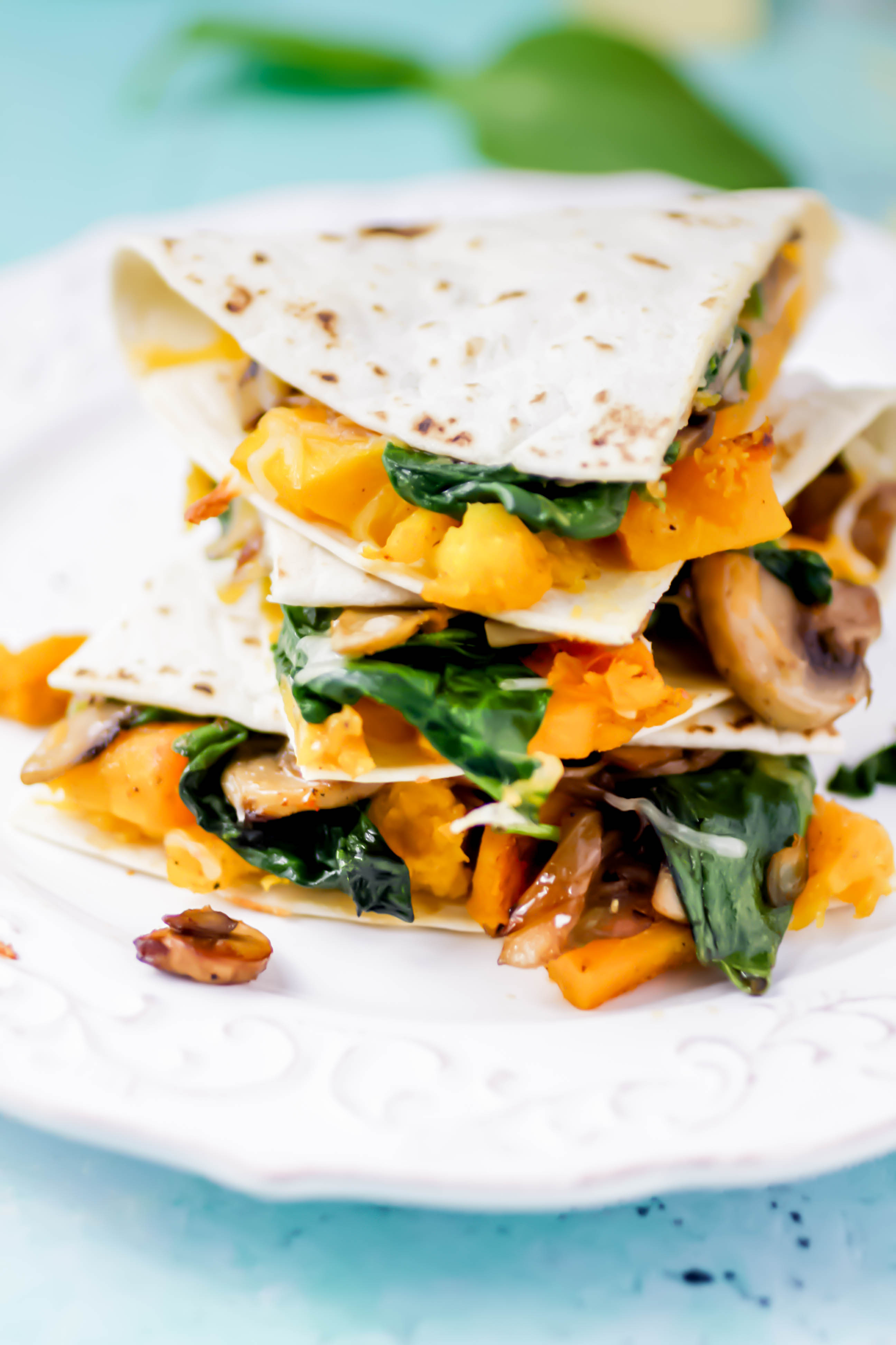Butternut Squash, Mushroom, Onion, and Spinach Quesadillas stack high for a delightful dish! Butternut Squash, Mushroom, Onion, and Spinach Quesadillas are super-flavorful and easy to make for your next dinner.