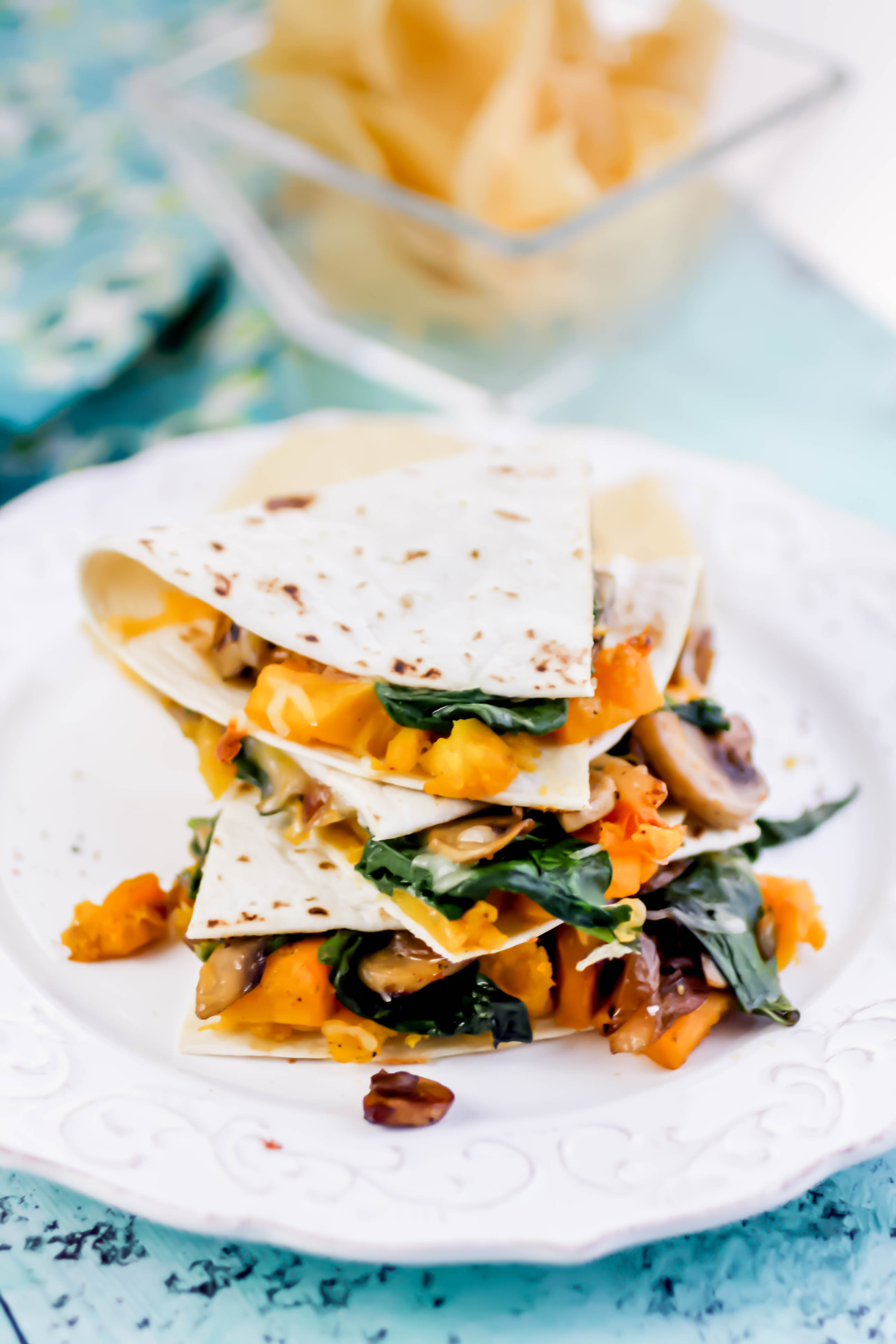 Butternut Squash, Mushroom, Onion, and Spinach Quesadillas are filling and delightful for any dinnertime menu! Butternut Squash, Mushroom, Onion, and Spinach Quesadillas are loaded with great ingredients for a tasty meal!
