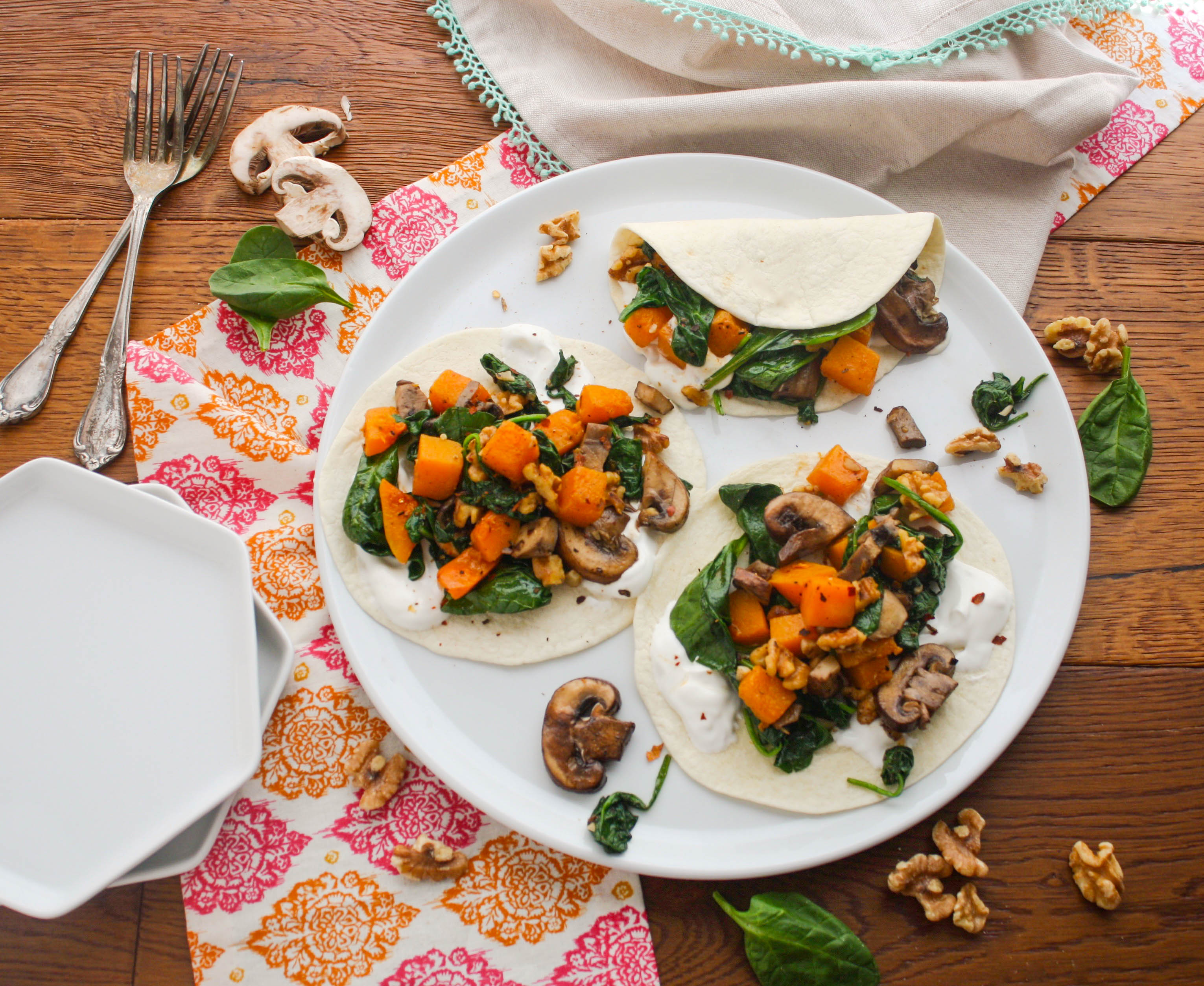 Butternut Squash, Spinach, and Mushroom Tacos are a tasty vegetarian and seasonal meal. You'll love these tacos!