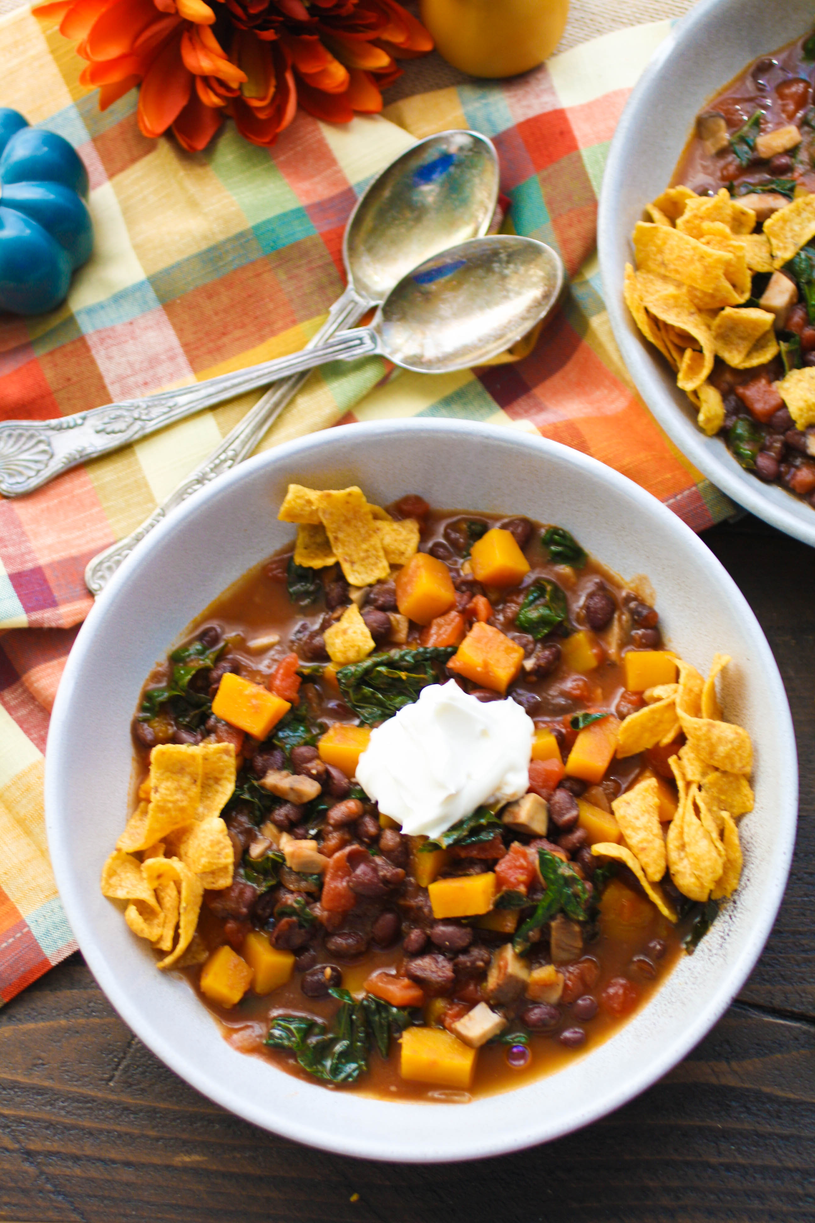 Grab a spoon and dig in to Butternut Squash and Black Bean Chili with Mushrooms & Kale. This recipe for Butternut Squash and Black Bean Chili with Mushrooms & Kale is ideal for Meatless Monday, or any night!