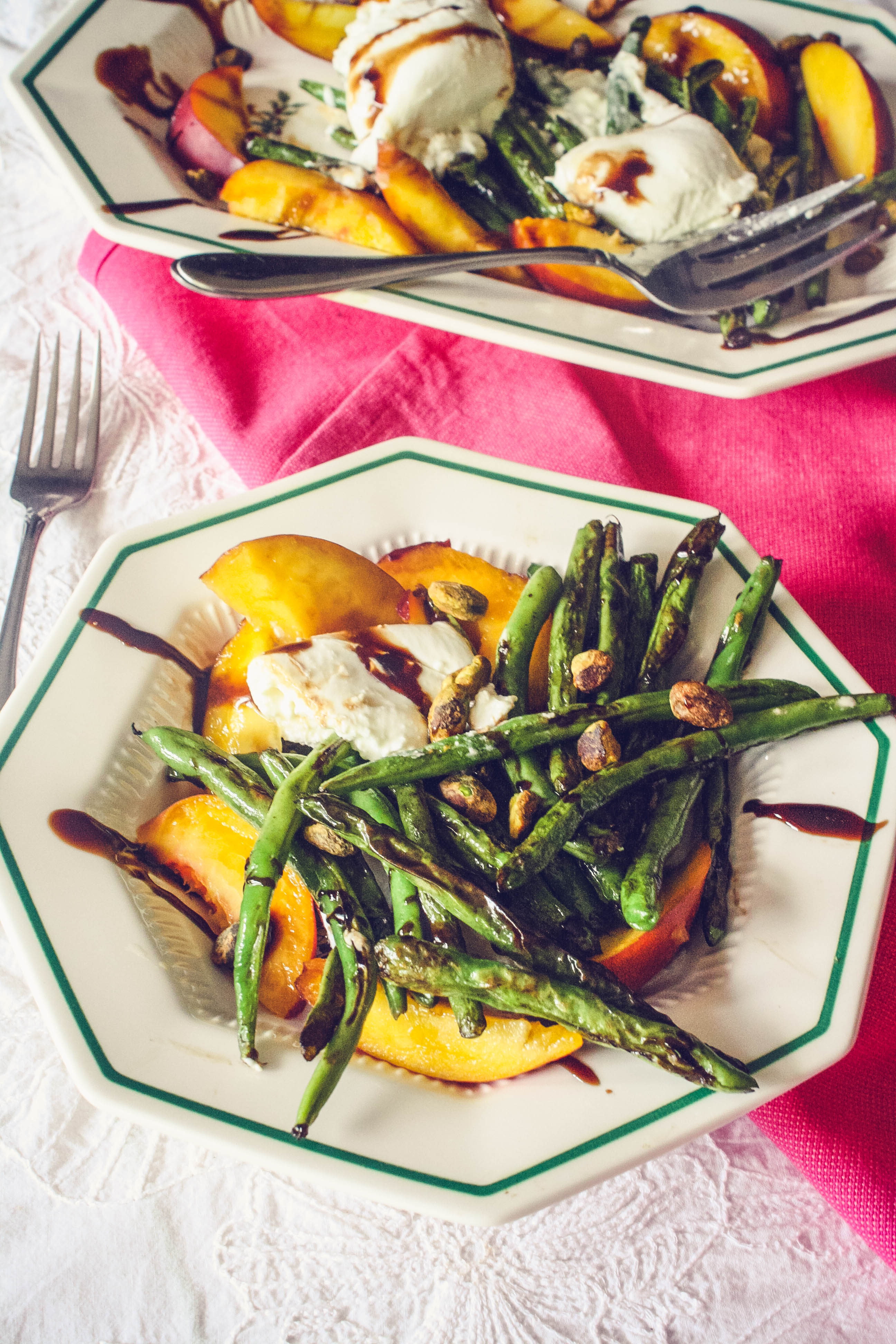 Charred Green Beans with Burrata and Peaches is a delightful summer dish. Charred Green Beans with Burrata and Peaches is perfect for the summer salad season!