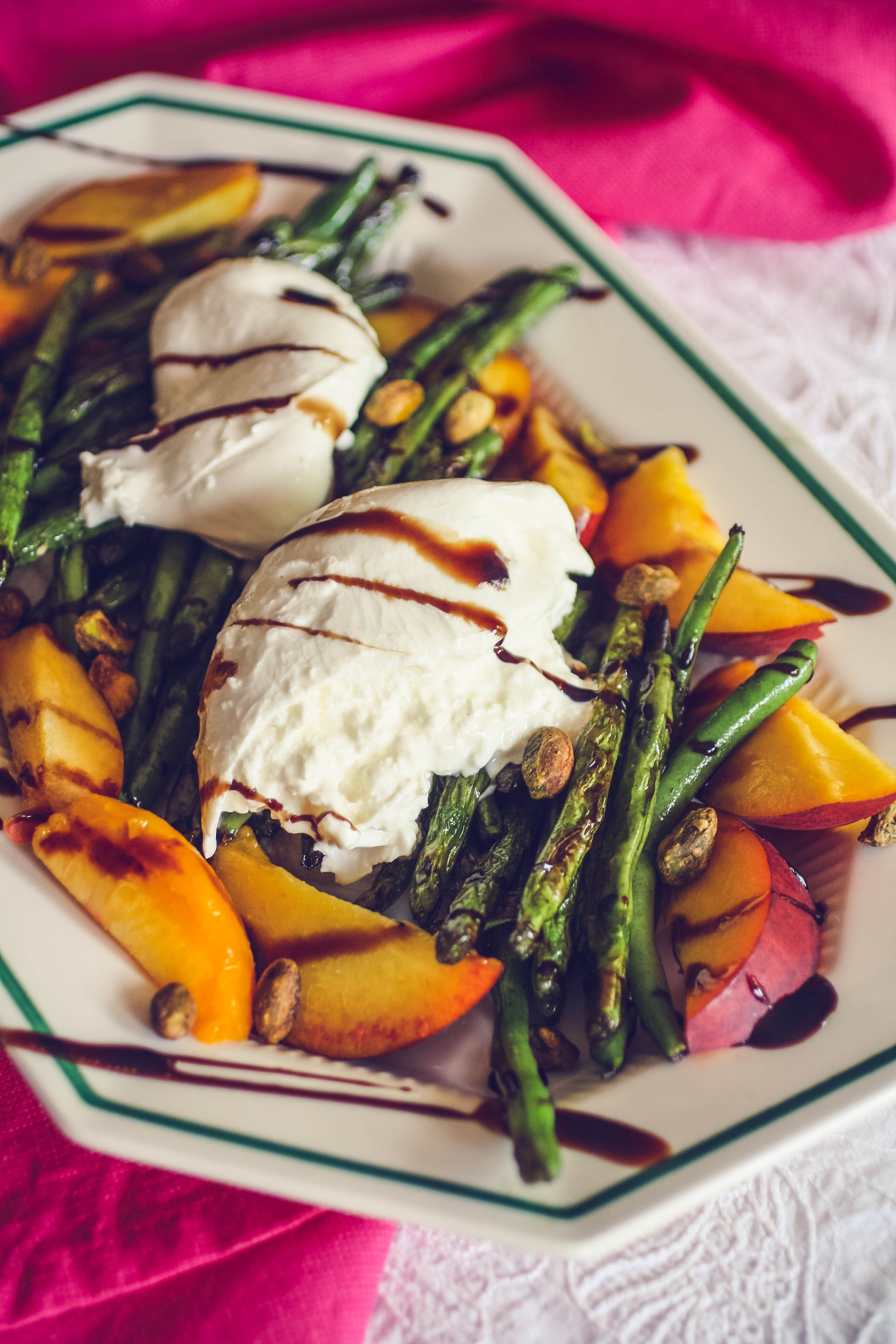 Charred Green Beans with Burrata and Peaches is a fun summer salad. Charred Green Beans with Burrata and Peaches is a delightful salad for the summer season.