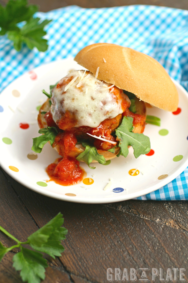 Serve sliders! Mozzarella-Stuffed Meatball Sliders are fun and delicious for any gathering!