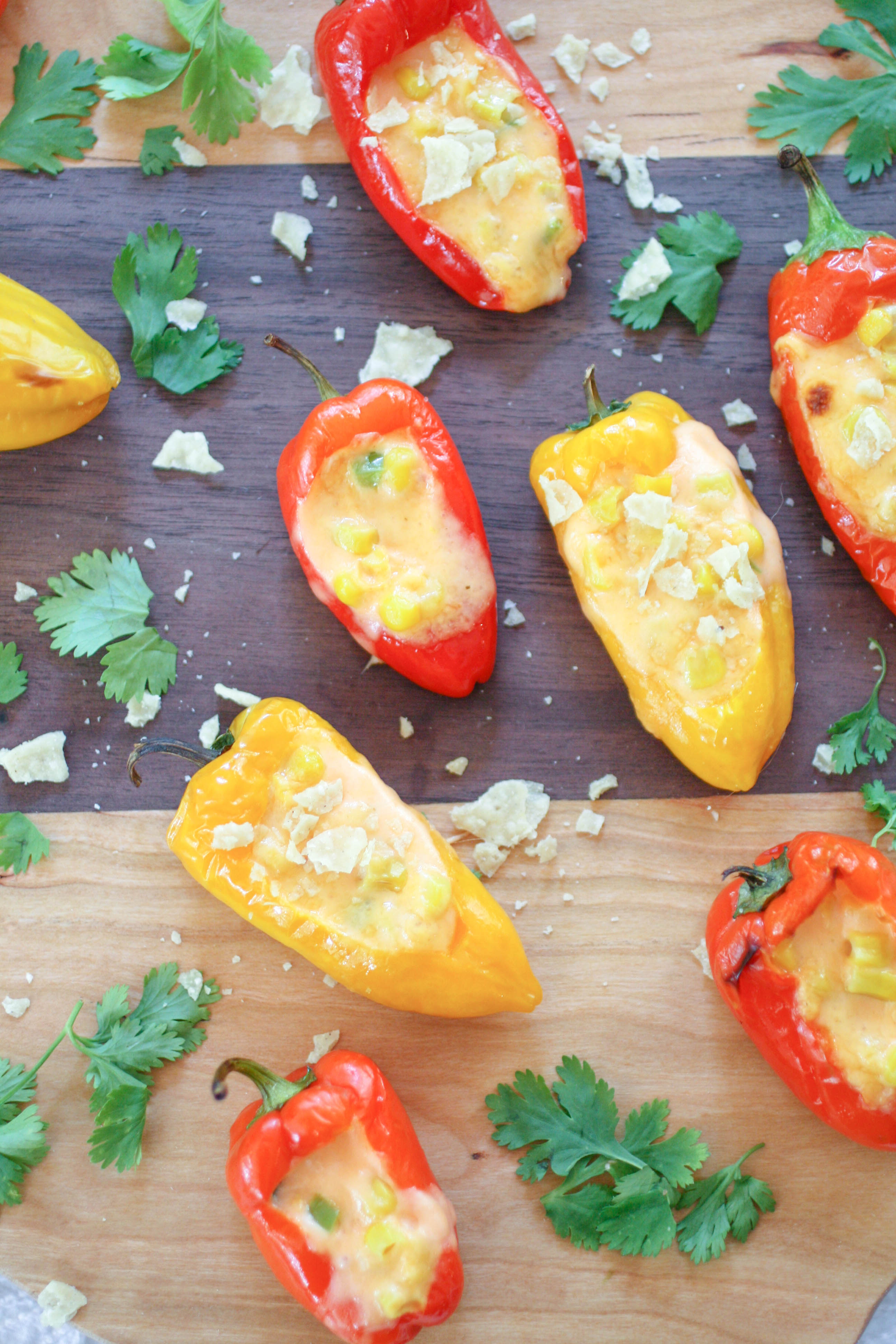 Cheesy Jalapeño & Corn Stuffed Sweet Pepper Poppers are colorful and delicious for your next appetizer! Cheesy Jalapeño & Corn Stuffed Sweet Pepper Poppers are easy to make for any gathering!