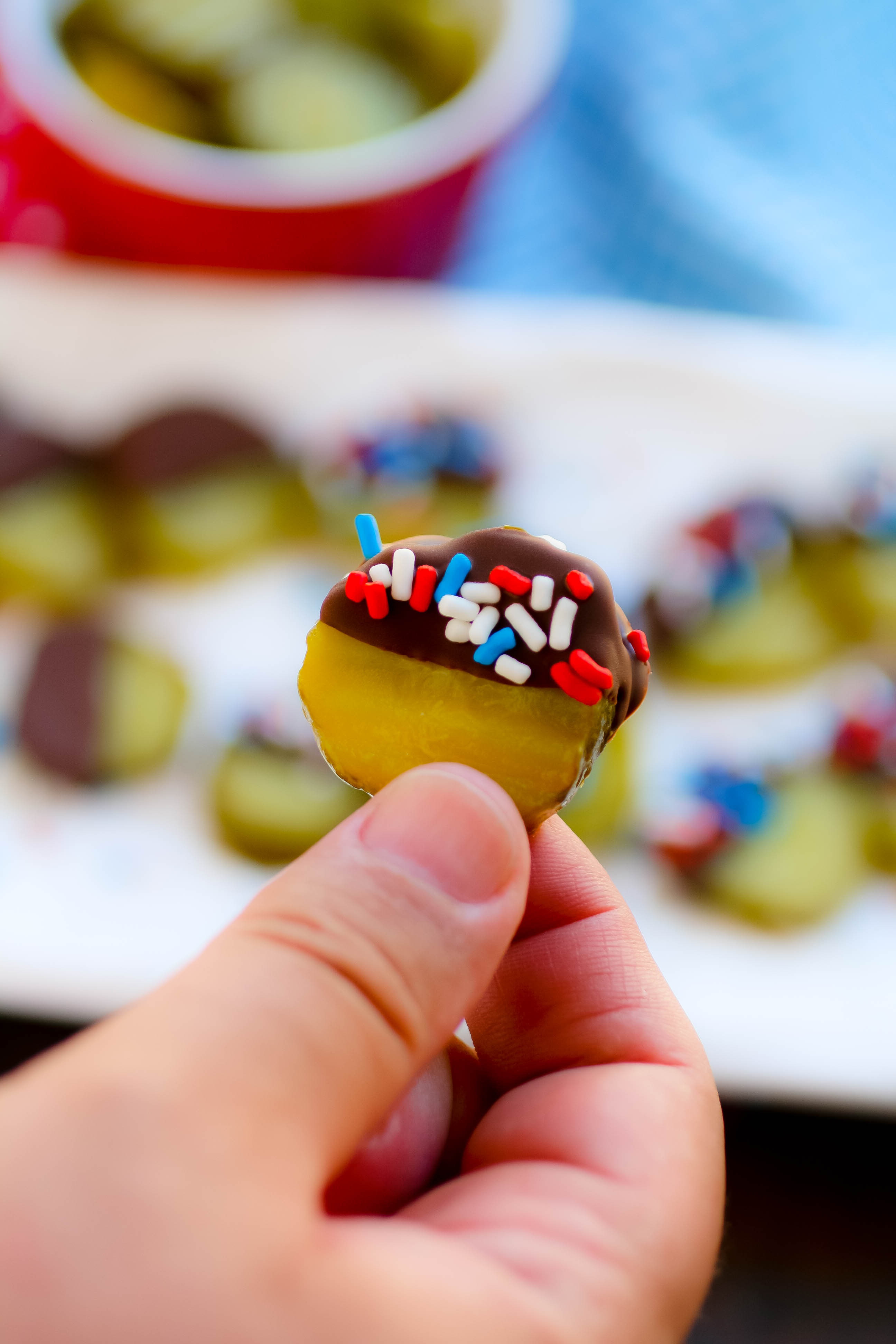 Chocolate Covered Pickles with Homemade Magic Shell are too fun for any get together! Chocolate Covered Pickles with Homemade Magic Shell are a fun treat for any gathering!