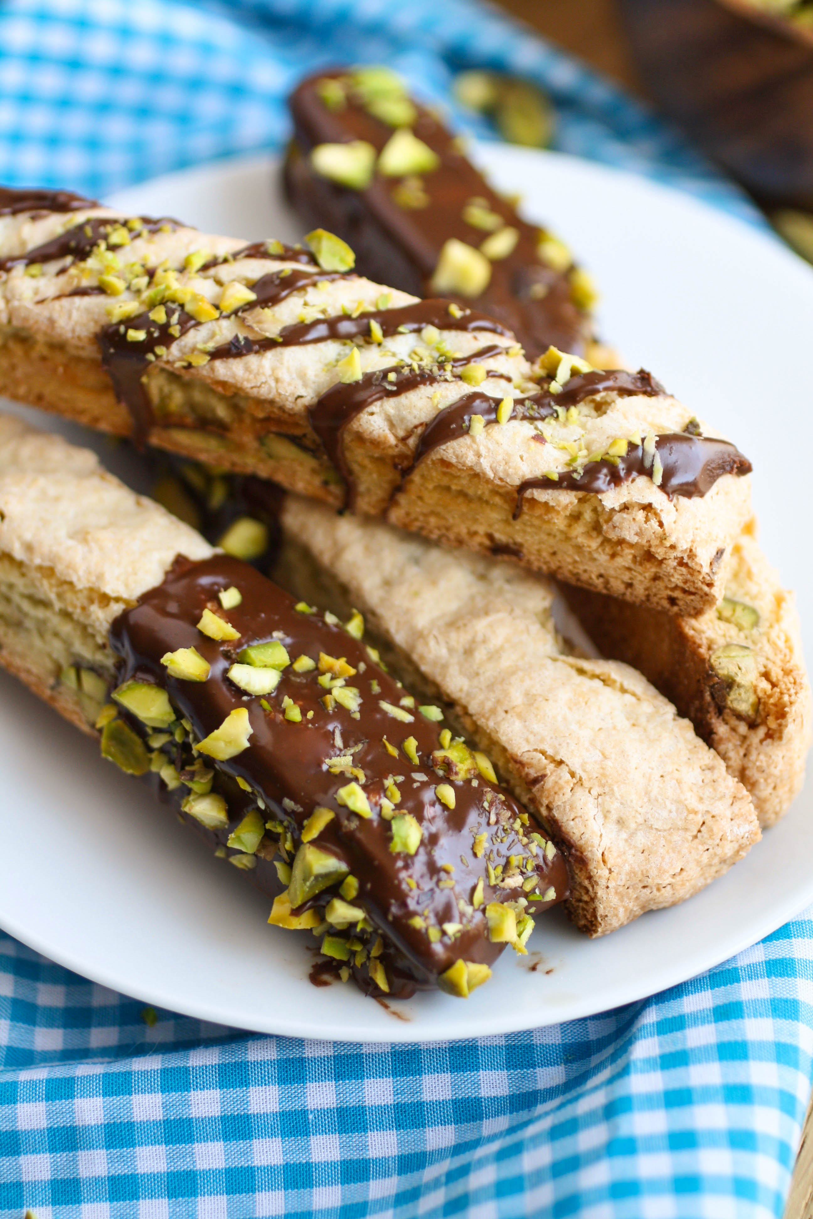 Chocolate-Espresso Dipped Orange and Pistachio Biscotti is an Italian-style cookie that is delicious served with coffee or milk! You'll love the flavors!