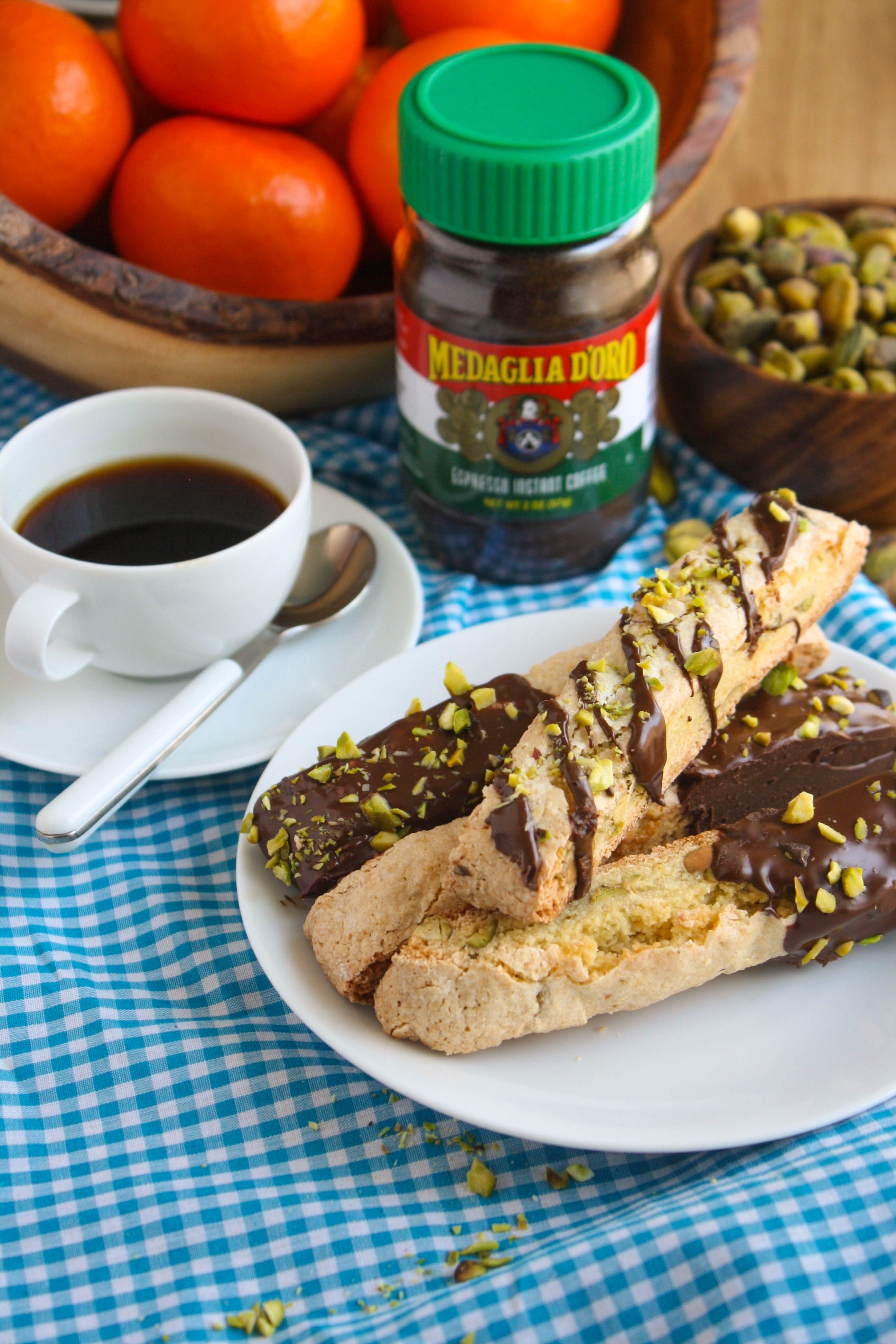 Chocolate-Espresso Dipped Orange and Pistachio Biscotti are such tasty cookies! You could serve these treats anytime, even at breakfast with coffee, or for dessert!