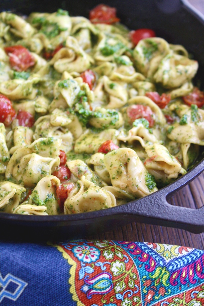 Creamy Skillet Tortellini with Arugula Pesto is a filling and colorful dish! This meatless dish is so easy to make, too!