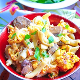 Creamy Pasta with Roasted Cauliflower and Mushrooms is a delightful and filling meal. You'll adore this Creamy Pasta with Roasted Cauliflower and Mushrooms dish.