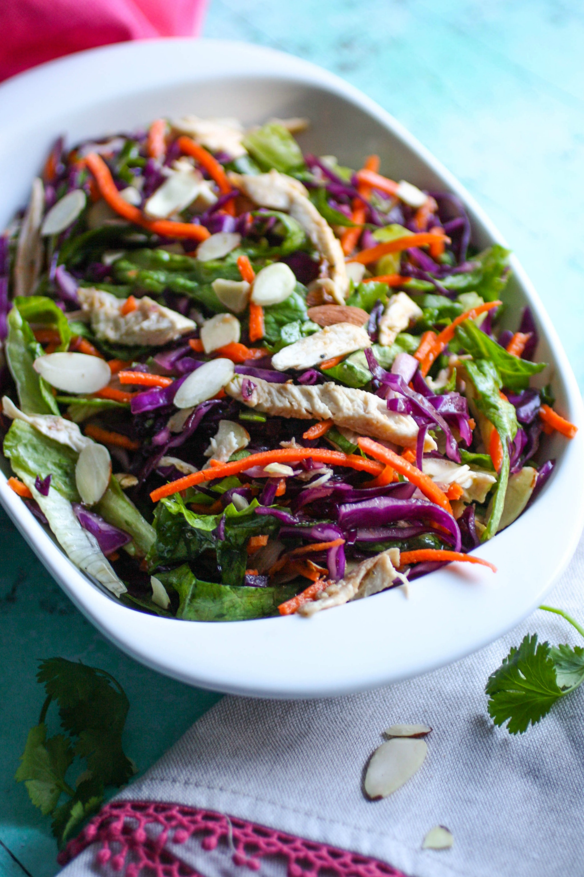 Crunchy Cabbage & Chicken Salad with Sesame Dressing is a lovely salad to serve with any meal. You'll love the crunch and color in this vibrant cabbage salad.