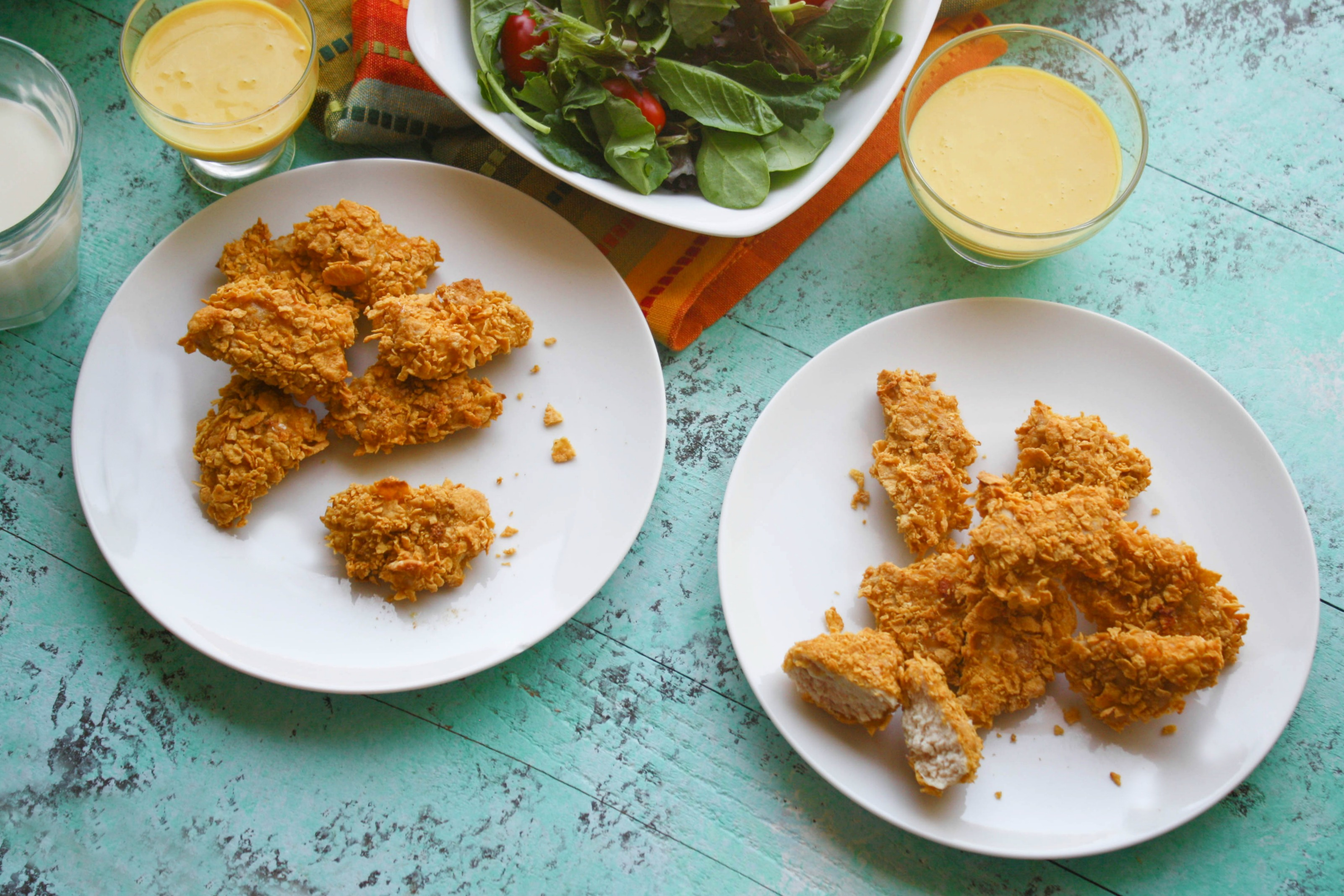 Crunchy Oven Baked Chicken Nuggets with Honey Mustard Sauce are perfect for kids of all ages! Everyone will love this chicken dish for dinner!