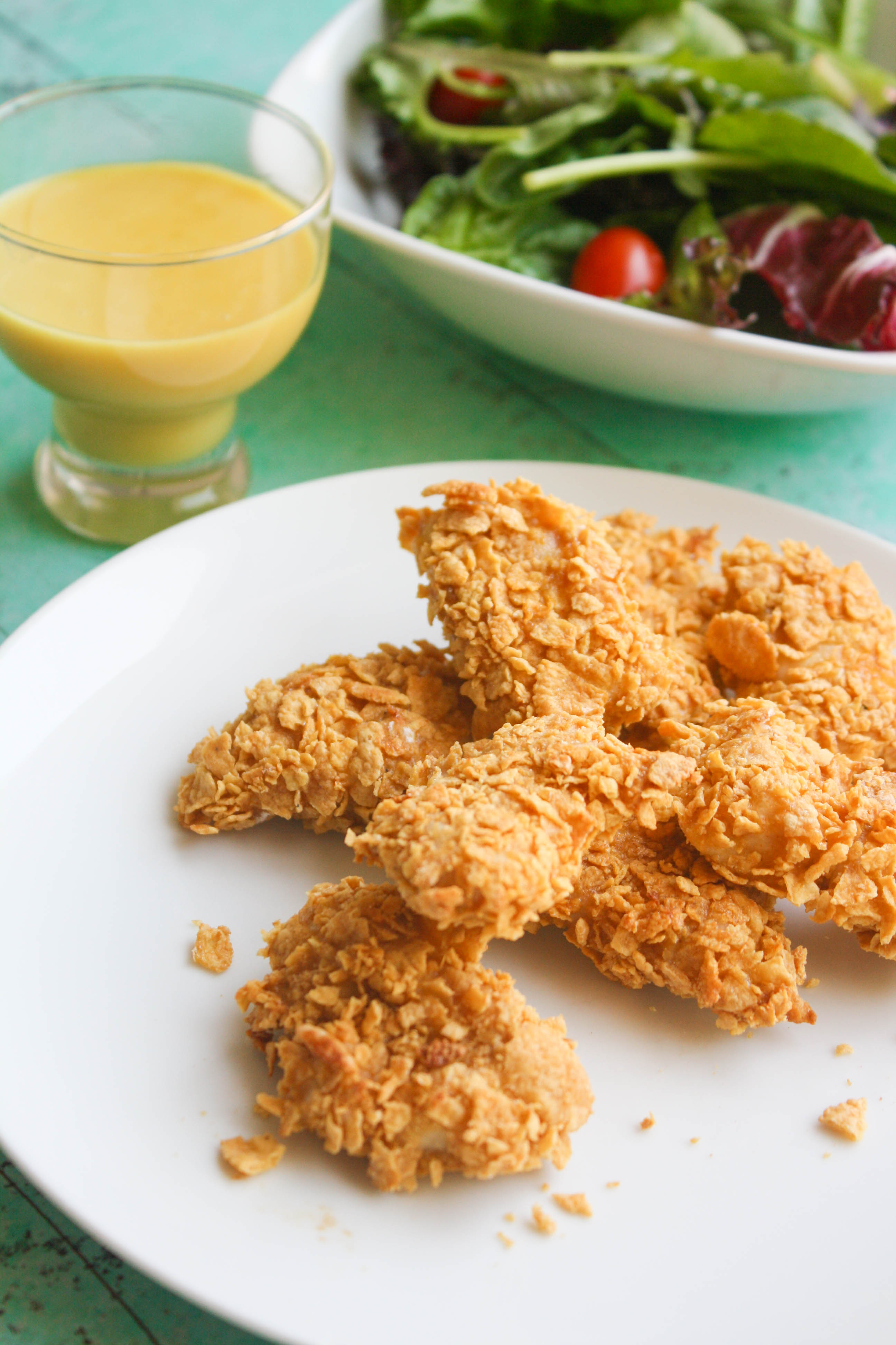 Crunchy Oven Baked Chicken Nuggets with Honey Mustard Sauce are bite-sized fun for dinner! You'll love that this dish is easy to make!