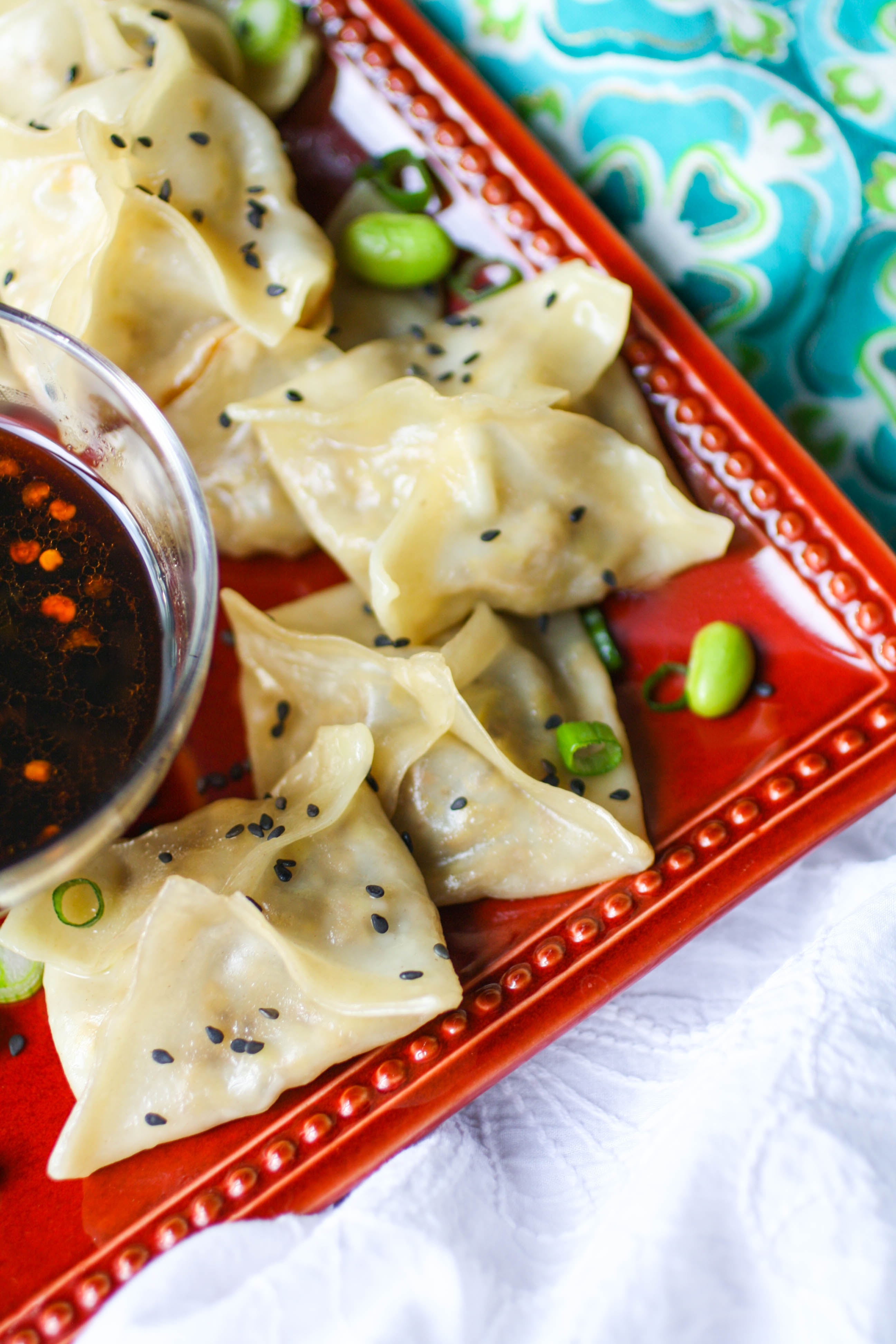 Edamame and Mushroom Potstickers with Dipping Sauce make a fabulous treat for party guests! You don't have to save these potstickers with dipping sauce for parties. Make them any night of the week!
