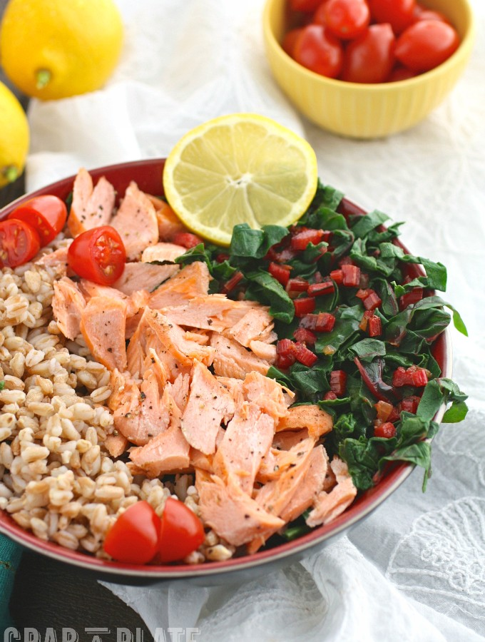 Indulge in a healthy, tasty bowl meal like Warm Farro, Salmon & Swiss Chard Bowls with Lemon Vinaigrette