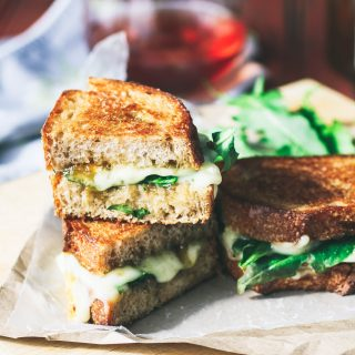 Grilled Brie, Fig Jam, and Dandelion Greens Sandwiches are delicious sandwiches for your next meal. Grilled Brie, Fig Jam, and Dandelion Greens Sandwiches make a unique and tasty meal.