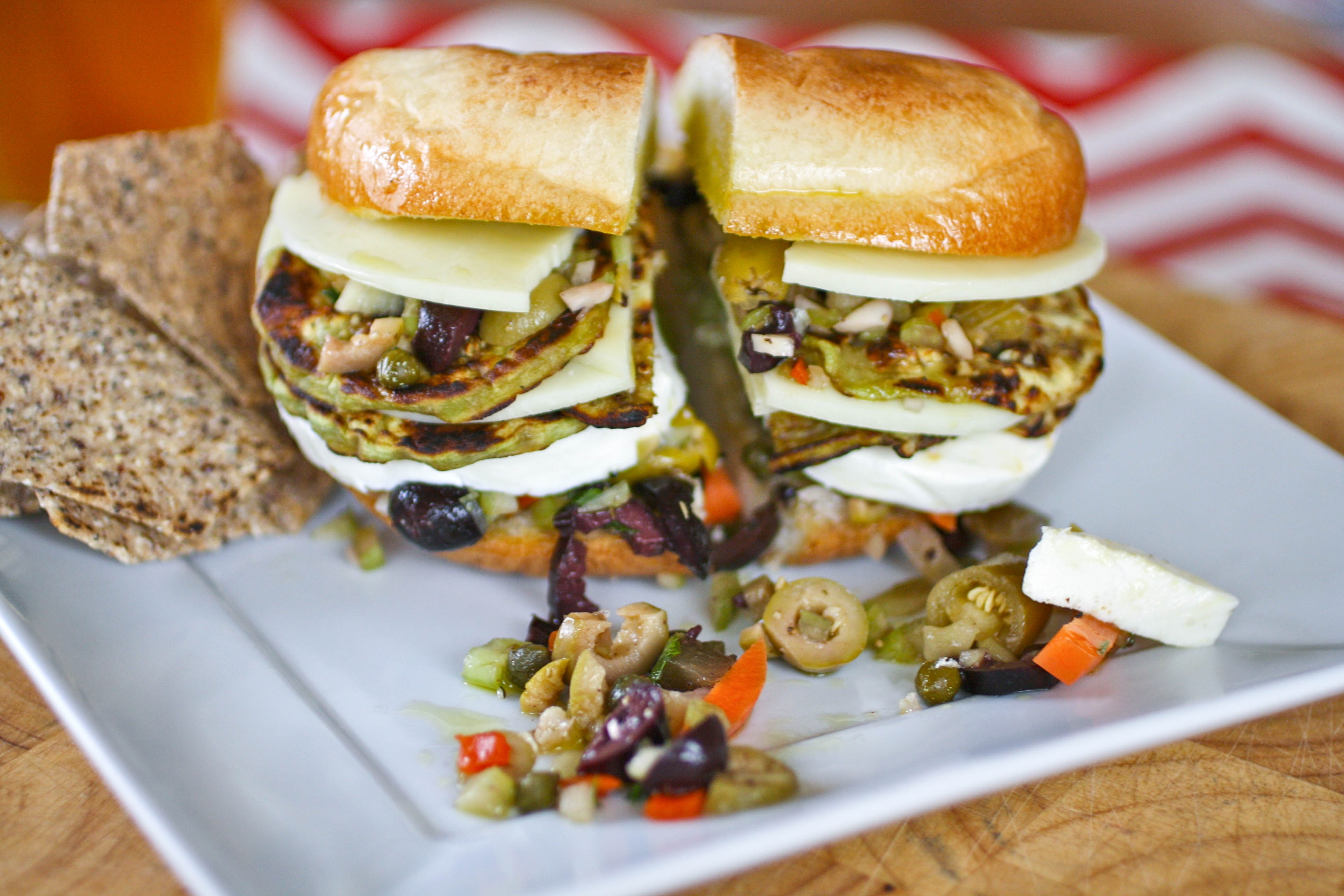Eggplant Muffuletta Sandwiches are a meatless version of the classic. You'll love these eggplant muffuletta sandwiches for a hearty, meatless meal.