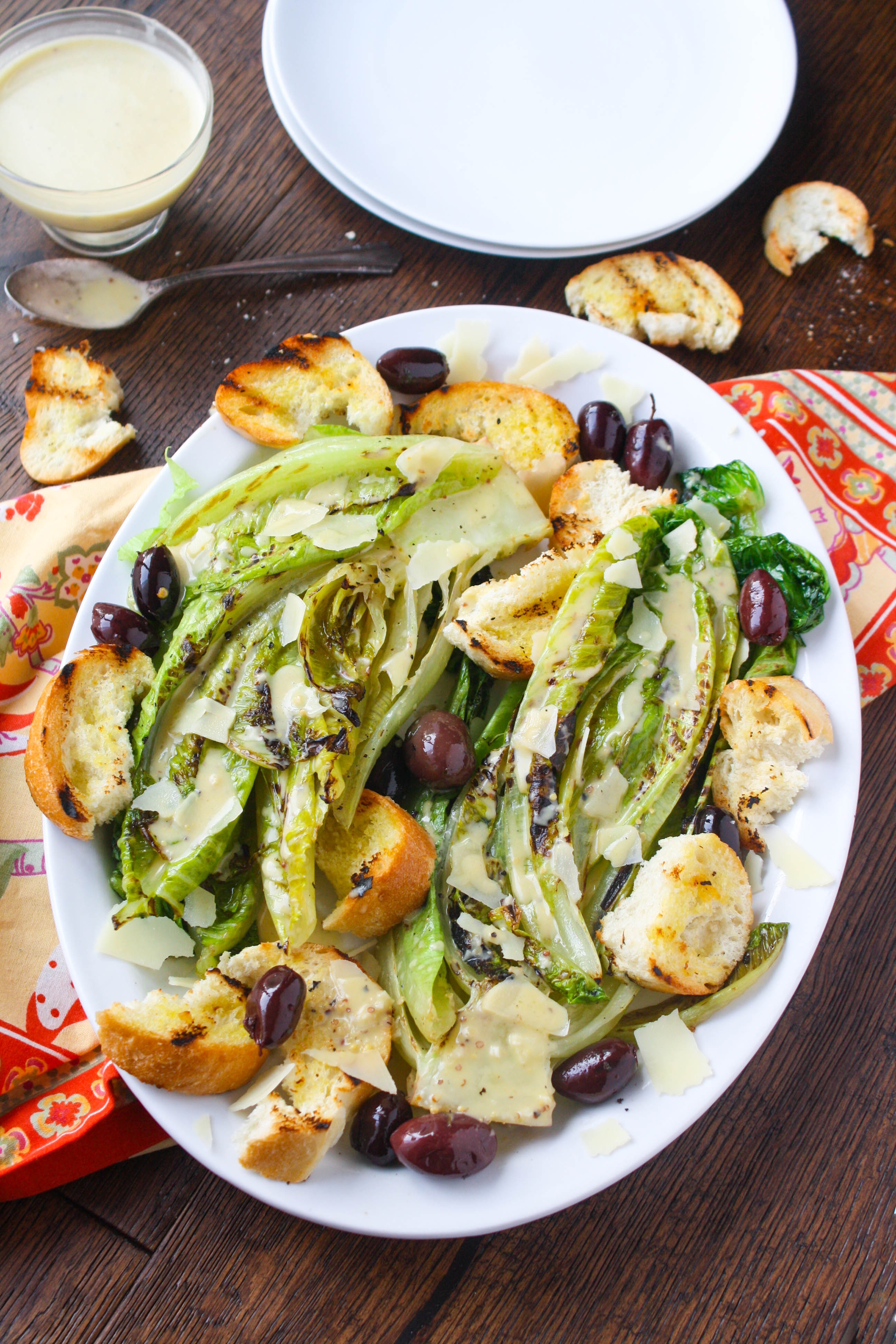 Grilled Romaine Salad with Caesar Dressing is a fun salad any time of year. You'll love the flavor grilling adds, and the dressing is delicious (with no egg included)!