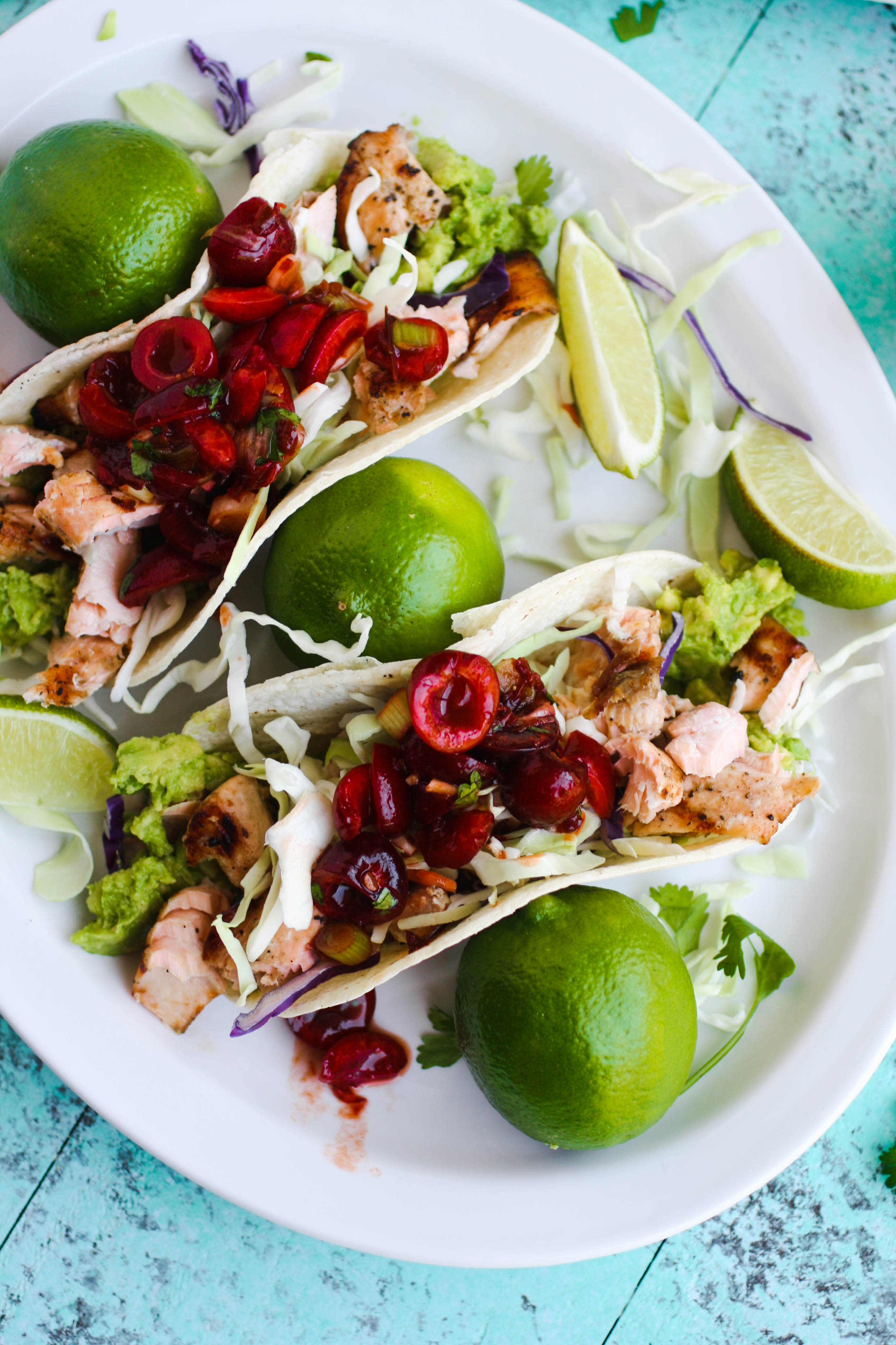 Grilled Salmon Tacos with Cherry-Chipotle Salsa is an amazing summer dish. You'll love everything from the salmon down to the fresh salsa!
