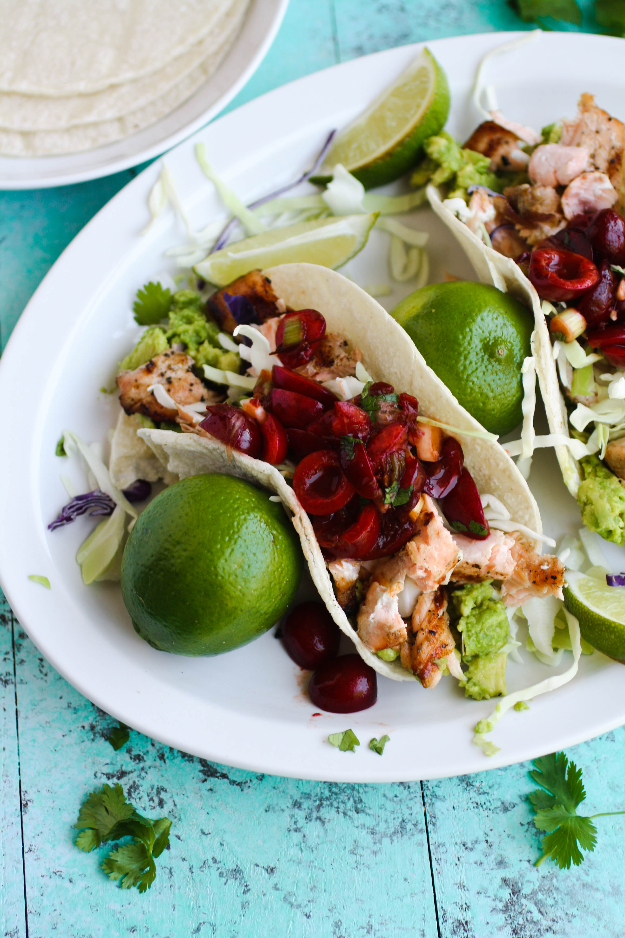 Grilled Salmon Tacos with Fresh Cherry-Chipotle Salsa is the perfect summer-season dish! You'll love to crack open the grill for these tacos!