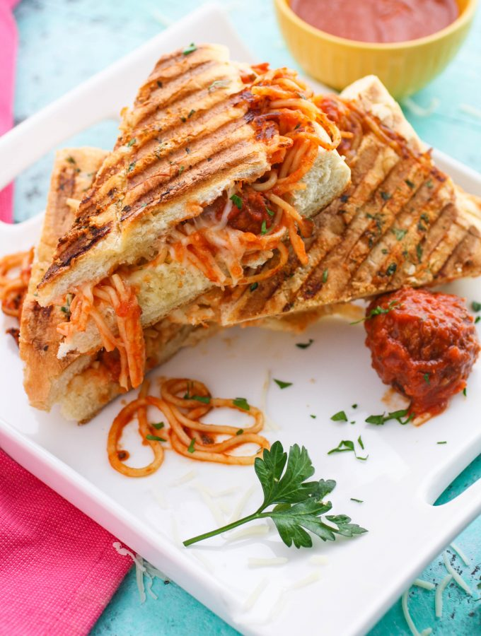 Leftover Spaghetti & Meatball Panini is a fun meal to use up last night's dinner! You'll love this dish that is so fun to serve!