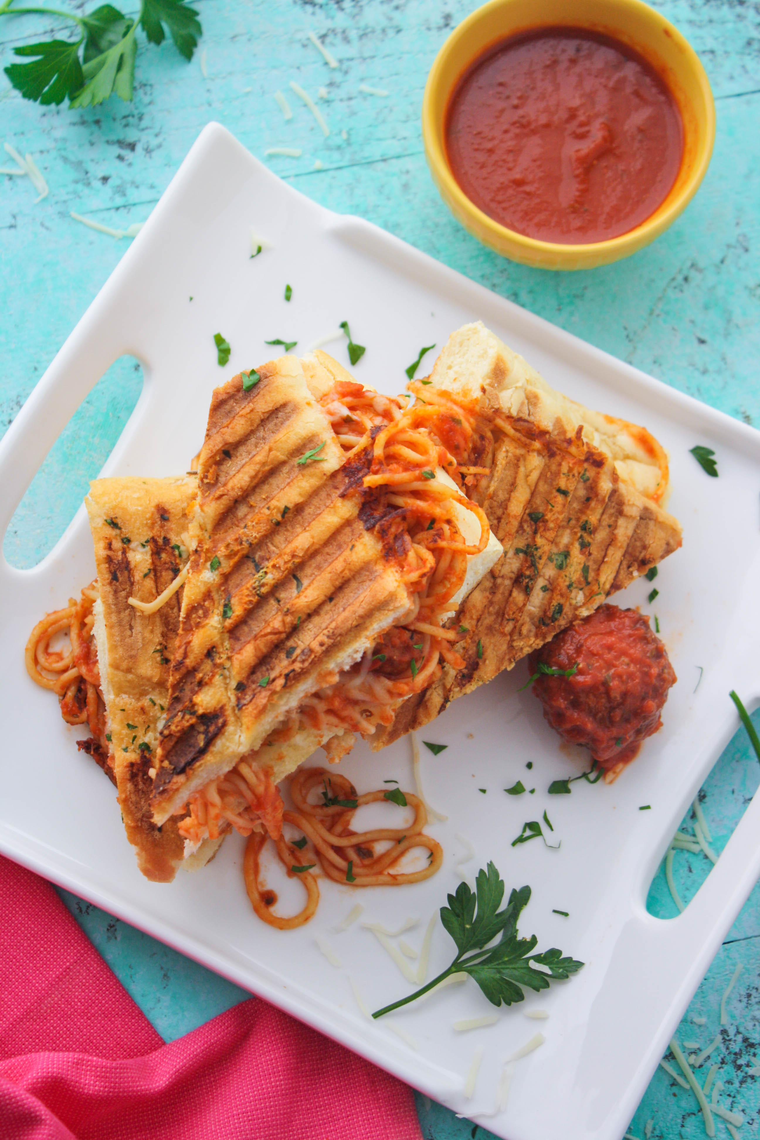 Leftover Spaghetti & Meatball Panini is a fun dish the whole family will enjoy! Leftovers get a fun makeover, for sure!