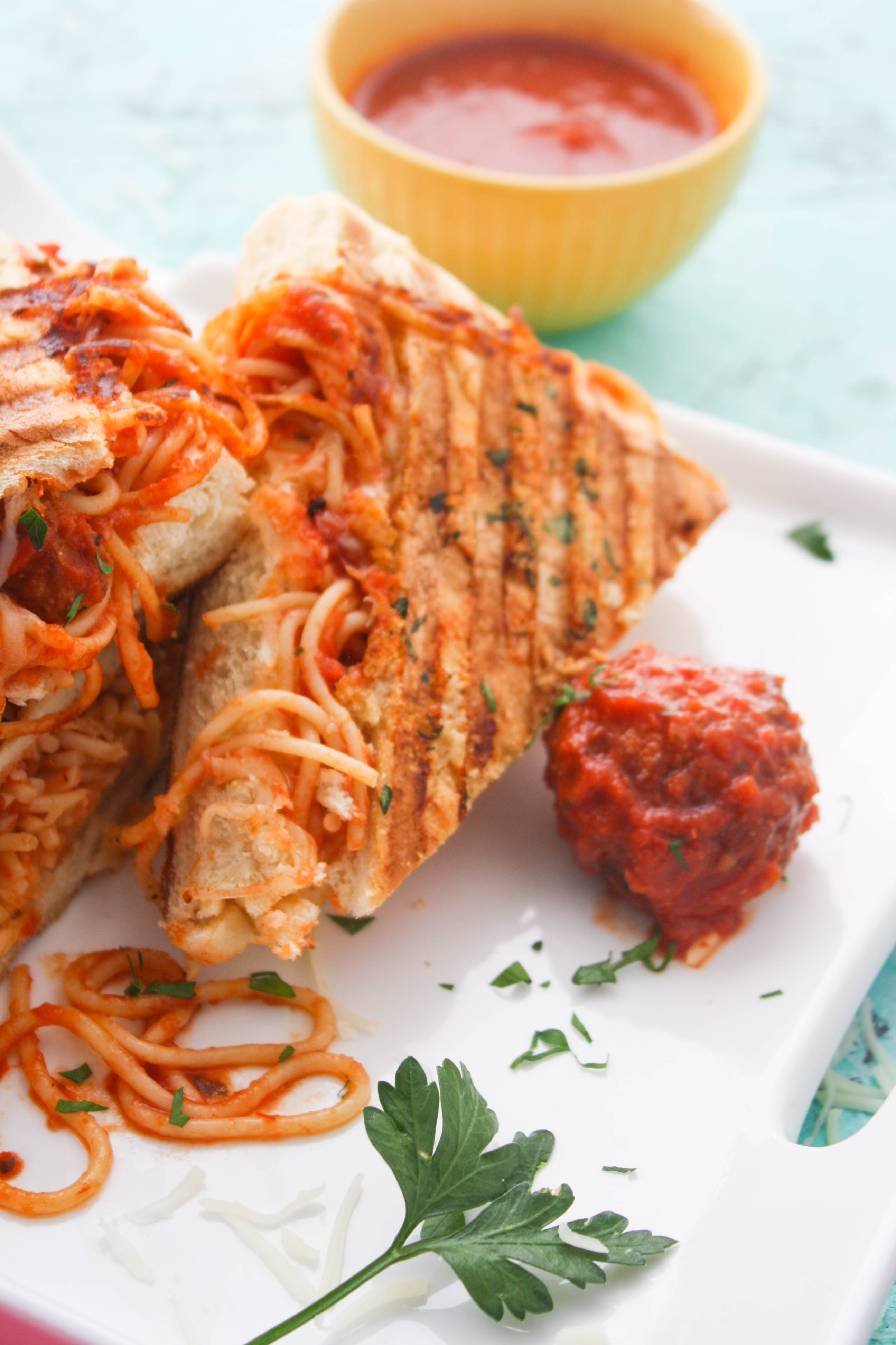 Leftover Spaghetti & Meatball Panini is a great dish to use up last night's meal! You'll love how fun this sandwich is!